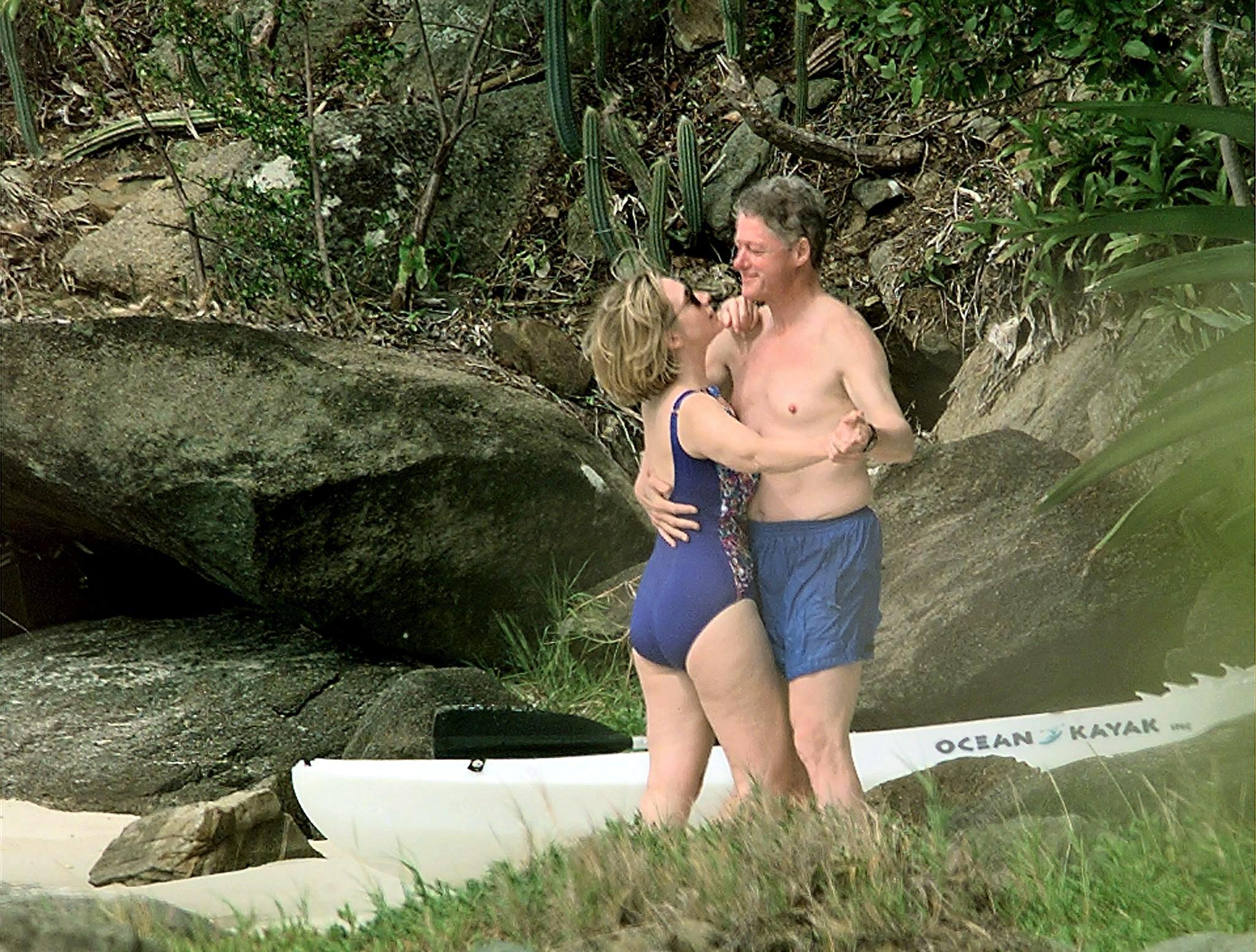 President Bill Clinton and First Lady Hillary Clinton dance on the beach of Megan Bay, St. Thomas, U.S. Virgin Islands shortly after taking a swim on Jan. 4, 1998.