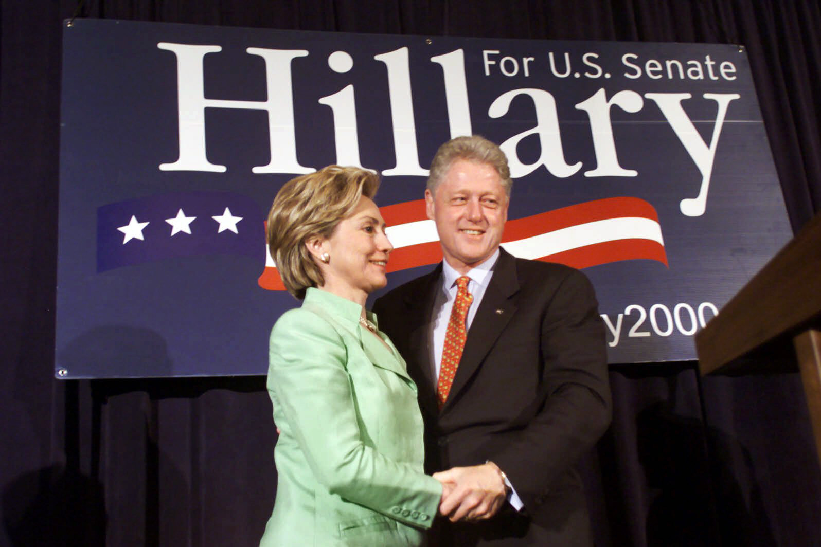 President Bill Clinton and  First Lady Hillary Rodham Clinton embrace during the New York State Senate luncheon on July 29, 2000 in New York City.