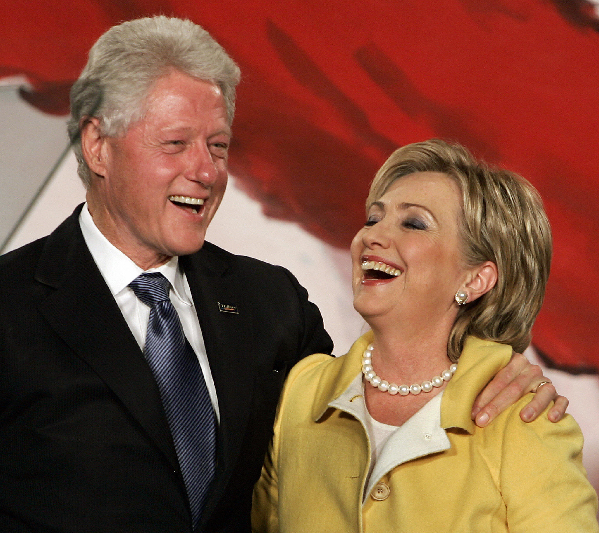 New York Sen. Hillary Clinton and her husband former President Bill Clinton smile after she won her second term, during a rally held by New York Democrats, in New York, on Nov. 7, 2006.