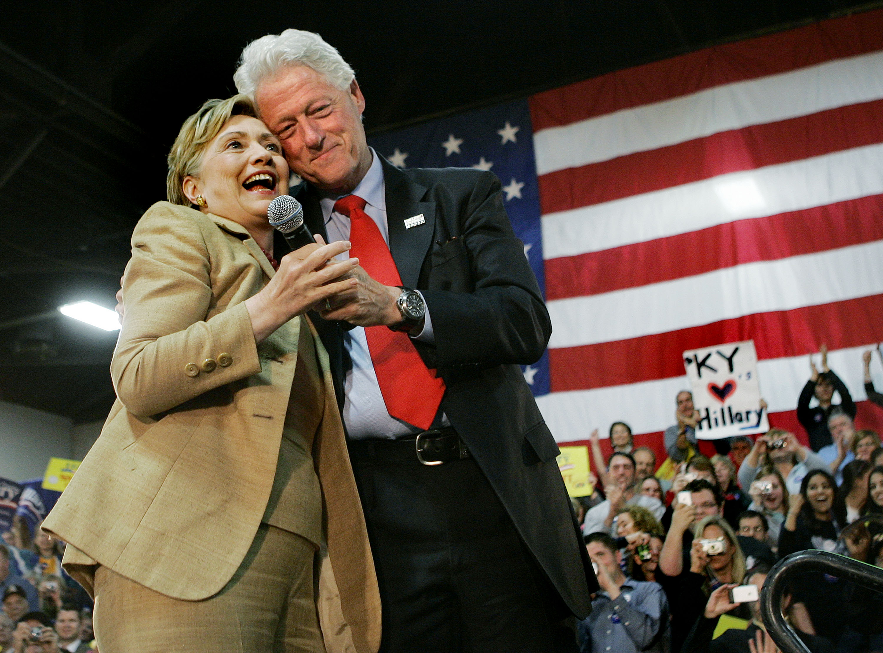 Democratic presidential hopeful Sen. Hillary Rodham Clinton, D-N.Y., is hugged by her husband, former President Bill Clinton as he introduces her during a campaign rally in Louisville, Ky. on May 19, 2008.