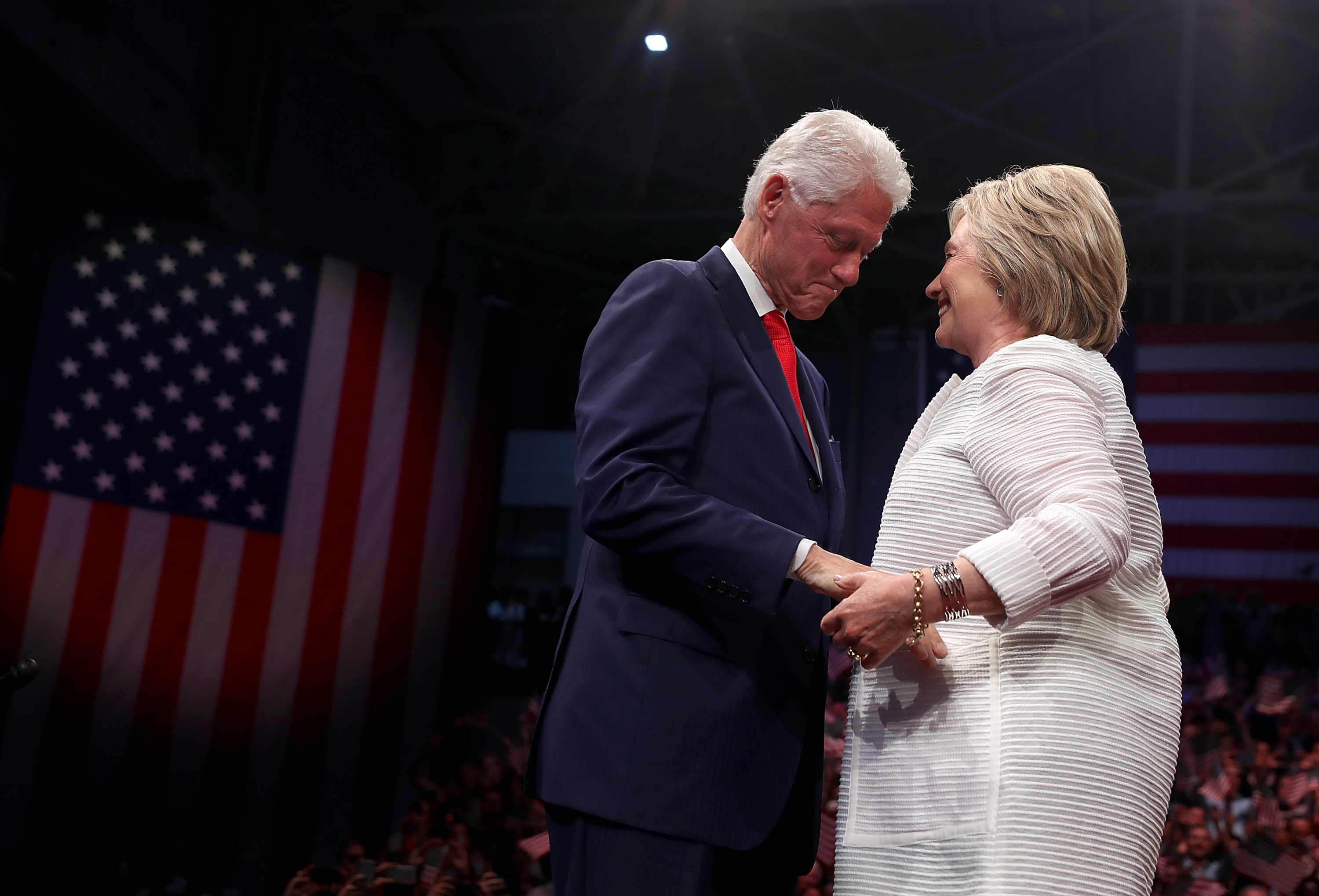 Democratic presidential candidate former Secretary of State Hillary Clinton and her husband former U.S. president Bill Clinton embrace during a primary night event on June 7, 2016 in Brooklyn, New York after Hillary Clinton surpassed the number of delegates needed to become the democratic nominee.
