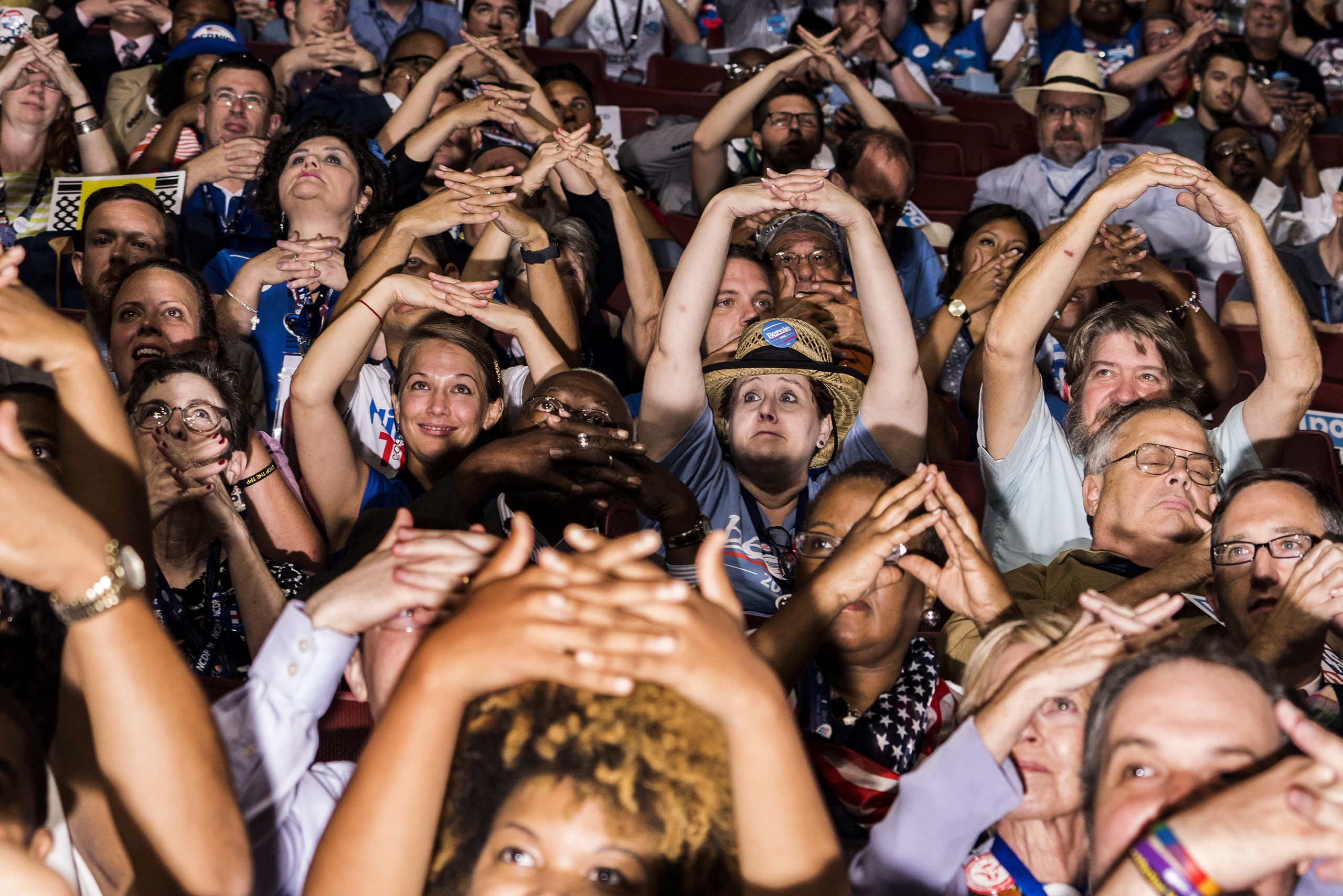"Former Iowa Sen. Tom Harkin taught delegates how to say ""America"" in sign language on the second day of the Democratic National Convention at the Wells Fargo Center, July 26, 2016 in Philadelphia, Pennsylvania."