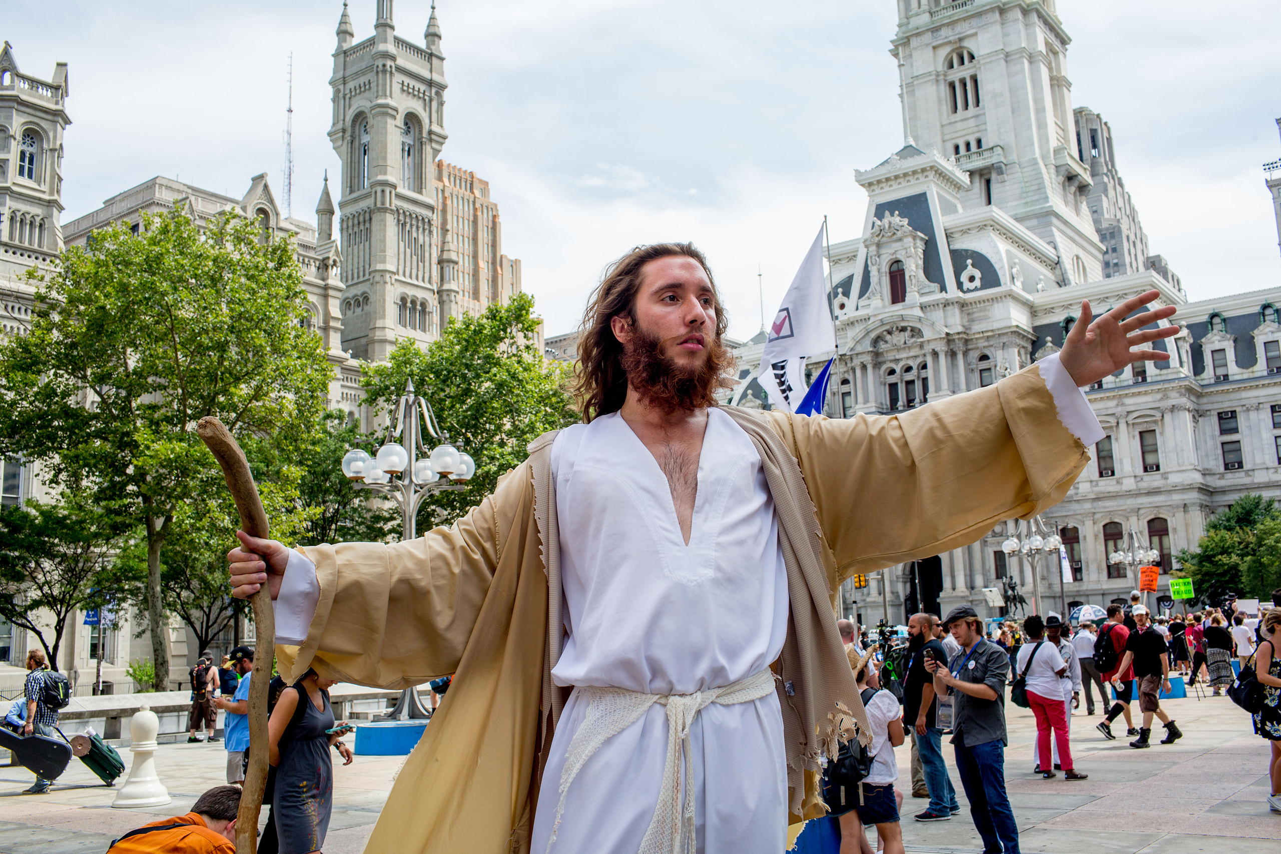 A protestor dressed like Jesus Christ near City Hall in Philadelphia on Tuesday afternoon to  protest the Democratic National Convention at the Wells Fargo Center on July 26, 2016.