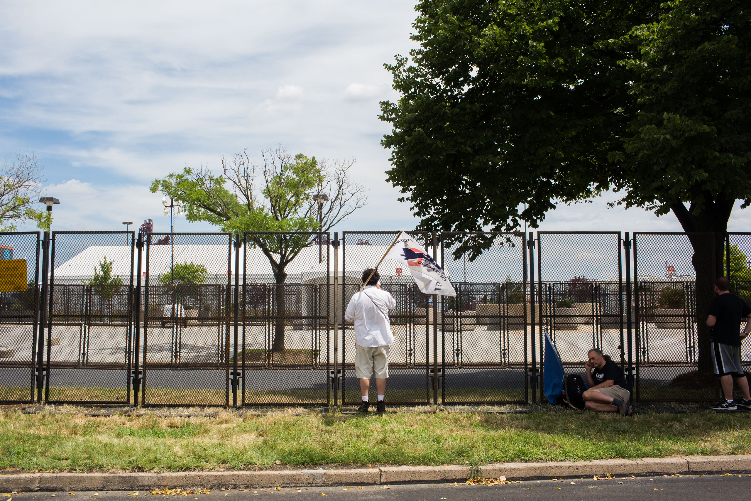 A protestor stands at a security fence outside the Democratic National Convention at the Wells Fargo Center in Philadelphia on July 26, 2016.