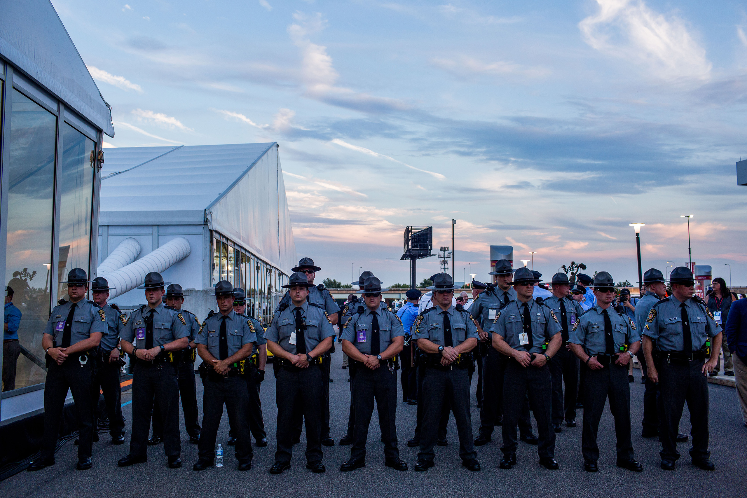 Police guard a protest of pro Bernie Sanders delegates at the media tent during the Democratic National Convention at the Wells Fargo Center on July 26, 2016 in Philadelphia.