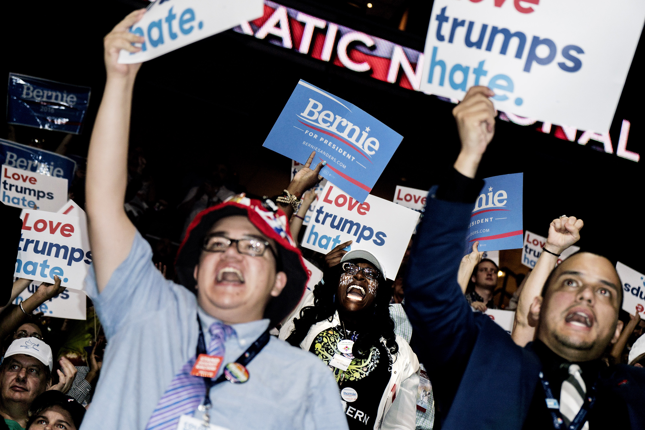 Delgates cheer on the first day of the Democratic National Convention at the Wells Fargo Center, July 25, 2016 in Philadelphia, Pennsylvania.