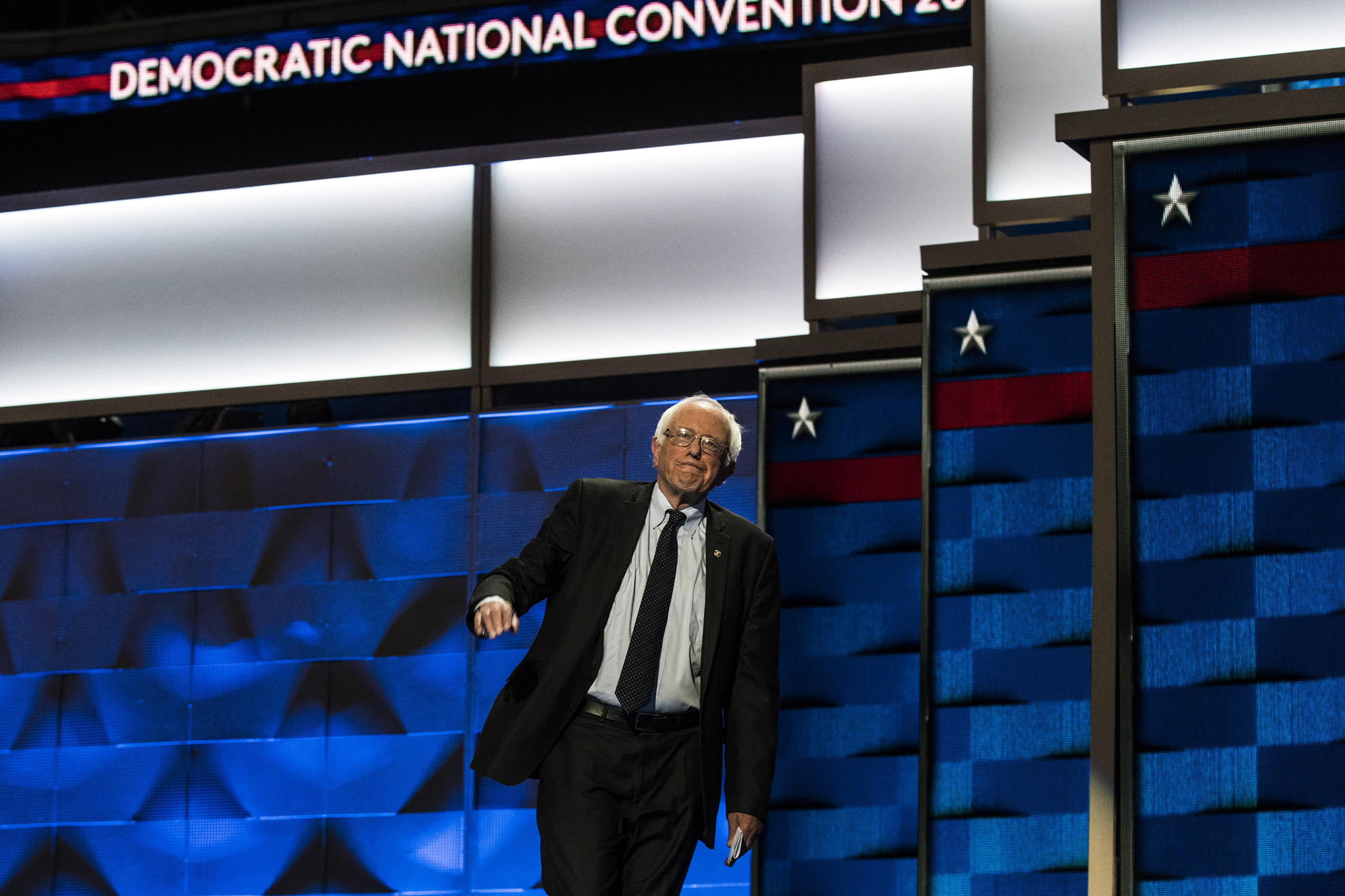 Sen. Bernie Sanders walks onto the stage before delivering remarks on the first day of the Democratic National Convention at the Wells Fargo Center, July 25, 2016 in Philadelphia, Pennsylvania.
