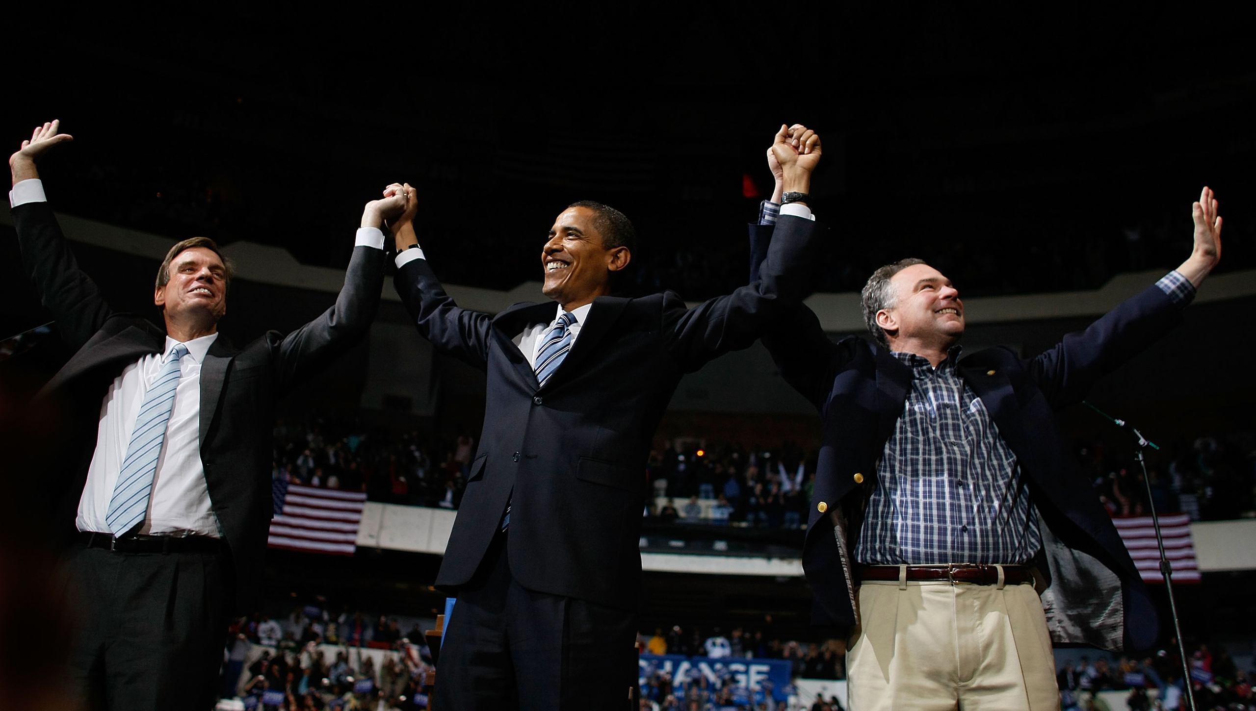Mark Warner, Democratic presidential nominee U.S. Sen. Barack Obama and Virginia Governor Tim Kaine raise their arms together during a campaign event at the Richmond Coliseum on Oct. 22, 2008.