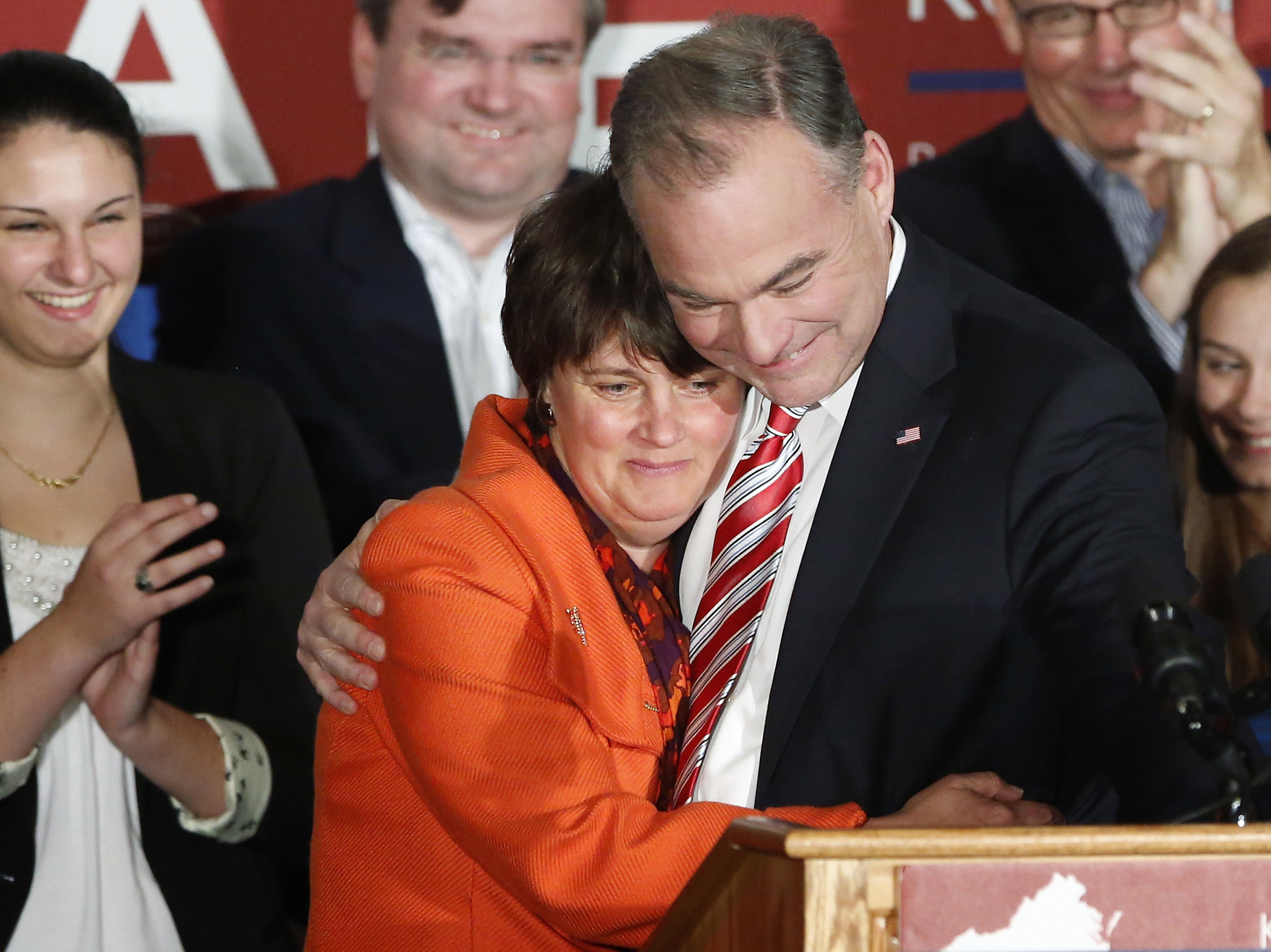 U.S. Senator-elect Tim Kaine hugs his wife Anne Holton as he celebrates his senate race victory on stage with supporters in Richmond on Nov. 6, 2012.