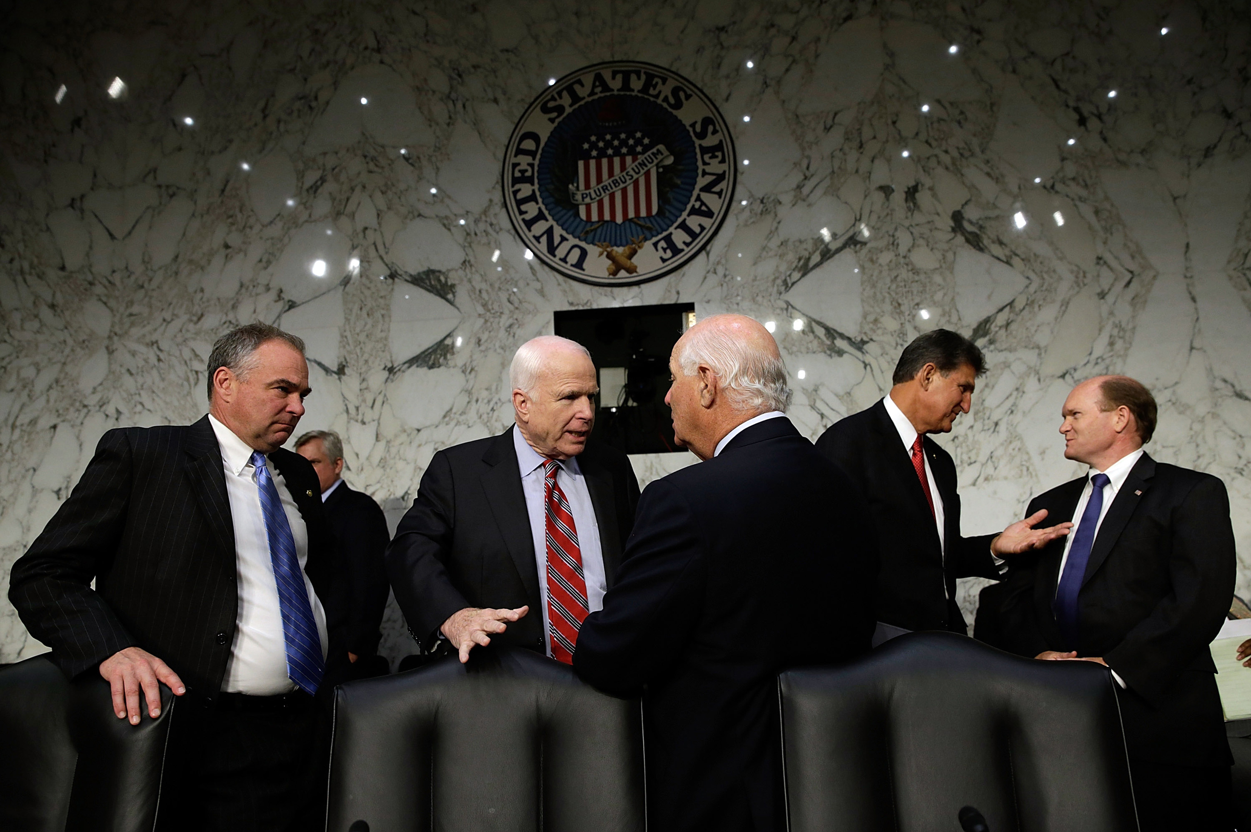 U.S. Sen. Tim Kaine, Sen. John McCain, Sen. Ben Cardin, Sen. Joe Manchin and Sen. Chris Coons confer before the testimony of U.S. Secretary of State John Kerry, U.S. Defense Secretary Chuck Hagel, and U.S. Chairman of the Joint Chiefs of Staff Gen. Martin Dempsey as they appear before the Senate Foreign Relations Committee on the topic of  The Authorization of Use of Force in Syria  in Washington on  Sept. 3, 2013.