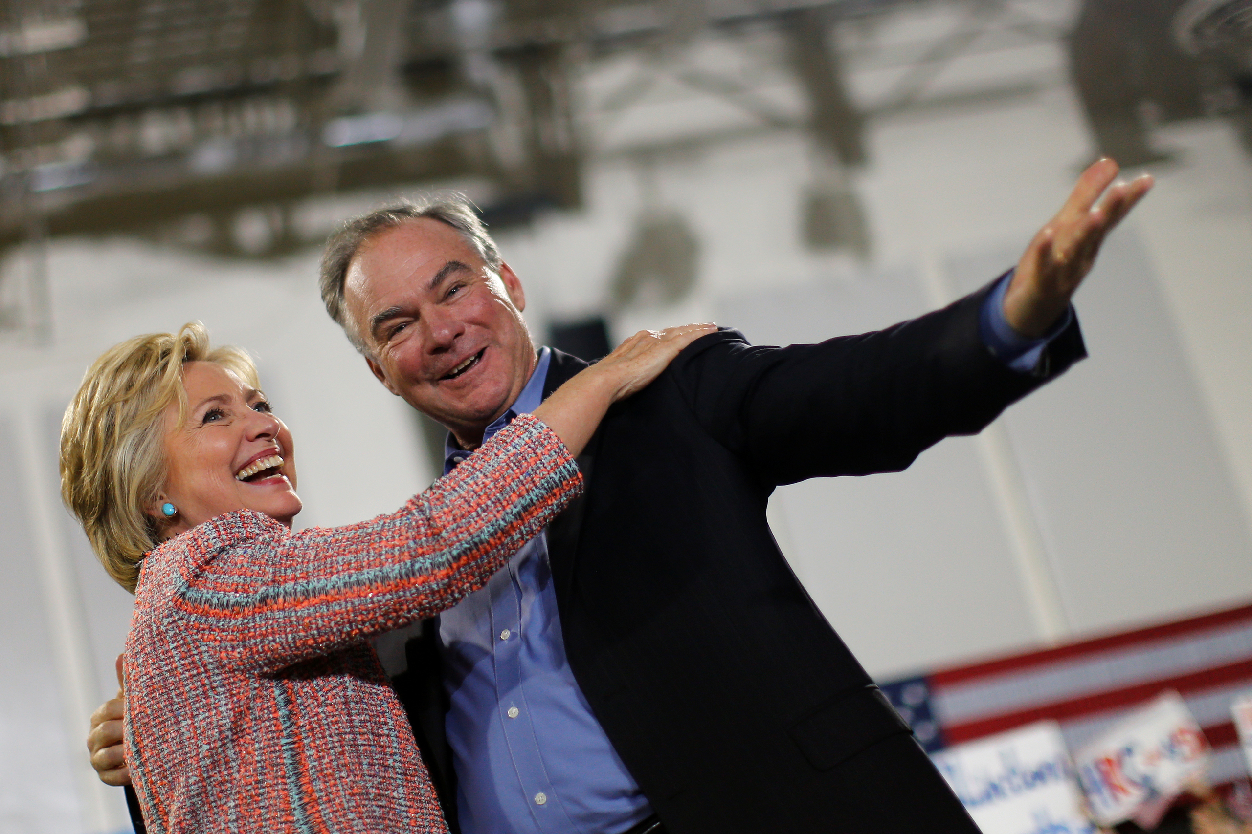Democratic U.S. presidential candidate Hillary Clinton and U.S. Senator Tim Kaine react during a campaign rally at Ernst Community Cultural Center in Annandale, Virginia on July 14, 2016.