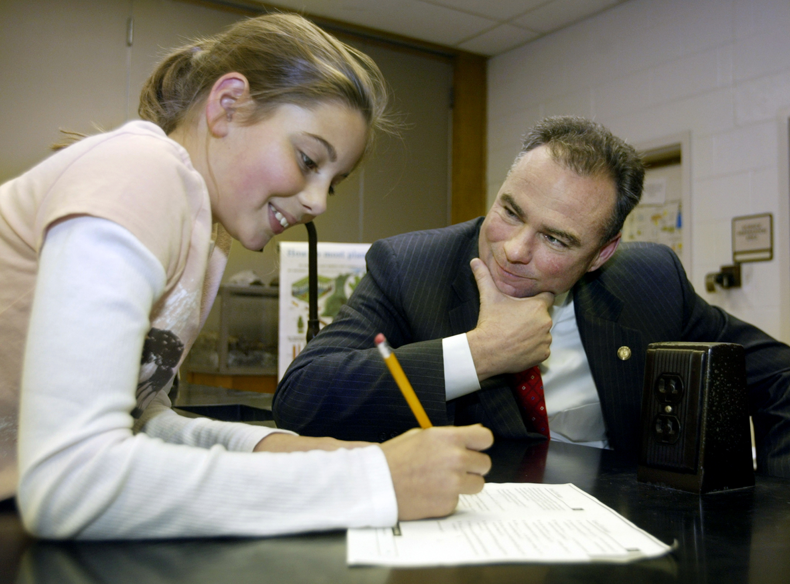 Virginia Gov. Tim Kaine and Aylor Middle School student Ryan Magalis, 11, left, work together on a word game in a gifted resource enlightment study hall at the school in Stephens City, Va. on Oct. 17, 2006.