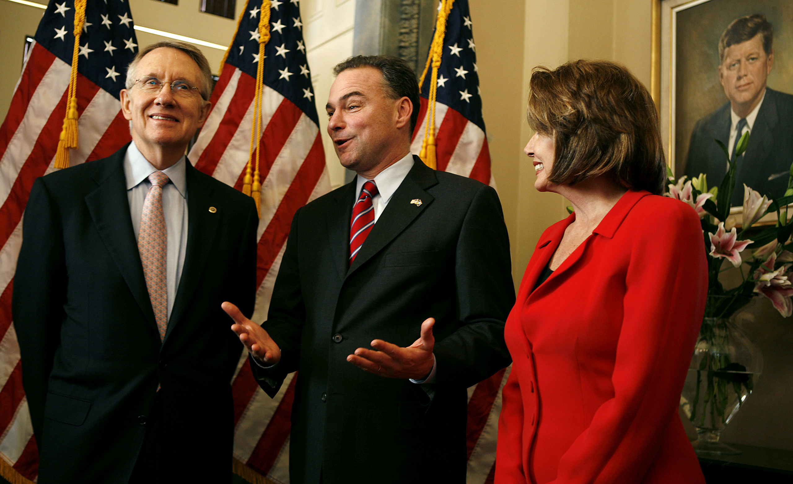 Senate Minority Leader Harry Reid left, Virginia Governor Tim Kaine center and House Minority Leader Nancy Pelosi pose for photographs on Capitol Hill in Washington on Jan. 31, 2006.