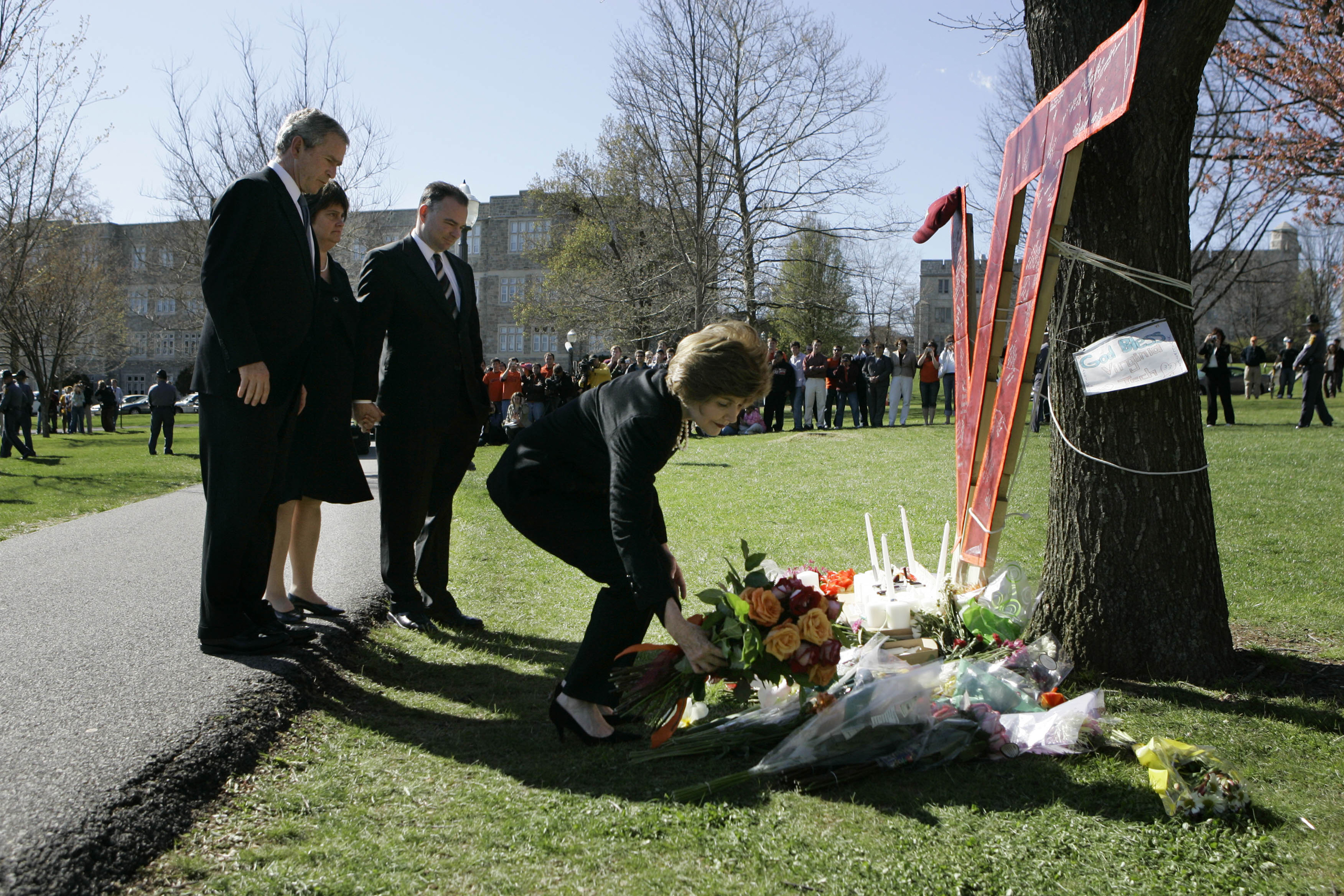 Former First lady Laura Bush, right, accompanied by Former President Bush, Anne Holton, wife of Virginia Gov. Tim Kaine and Gov. Kaine, lays flowers at a memorial for the Virginia Tech shootings victims in Blacksburg, Va.on April 17, 2007.