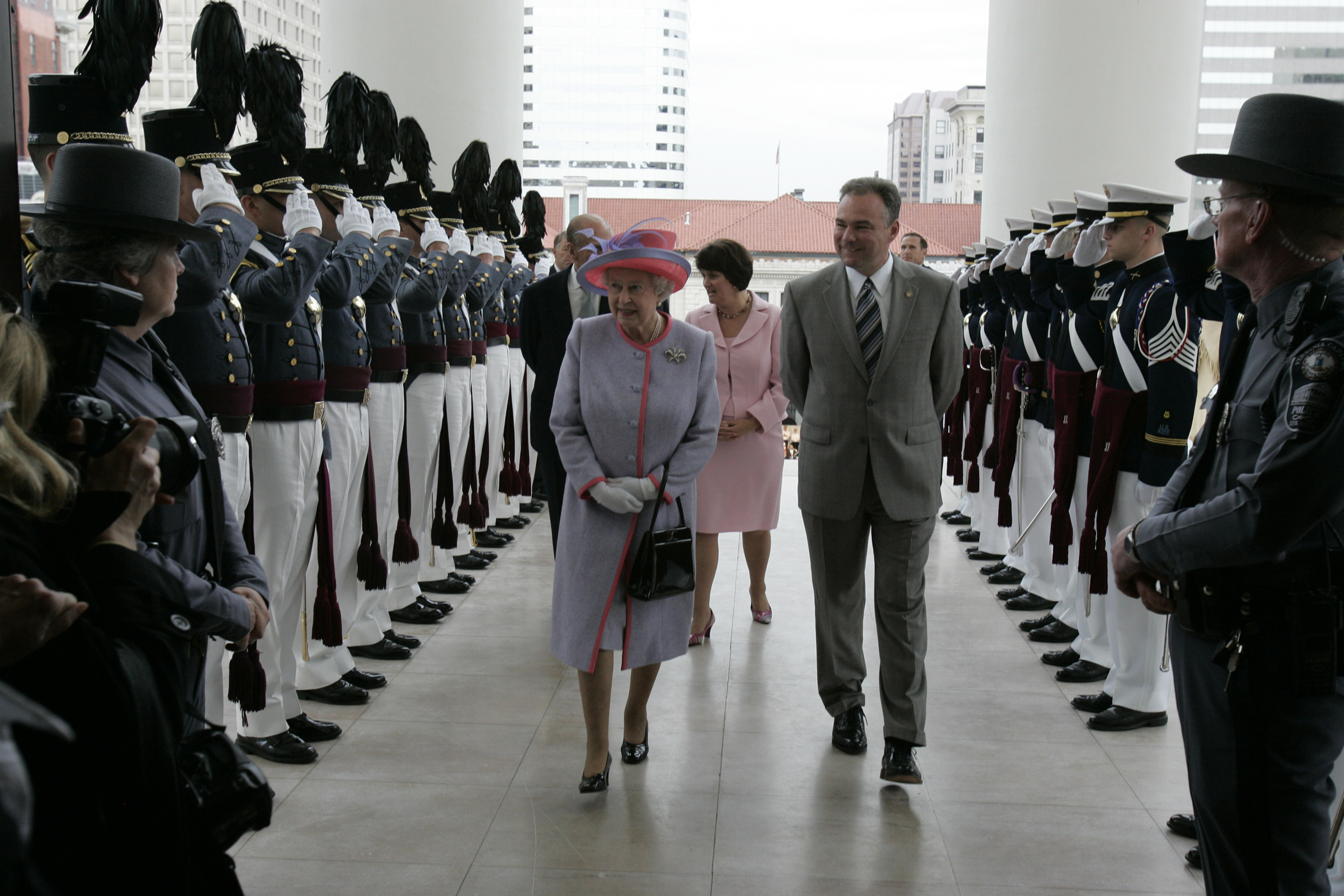 Members of the Virginia Military Institute Corps of Cadets, left, and the Virginia Tech Corps of Cadets, right, salute as Queen Elizabeth II and Virginia Gov. Tim Kaine enter the Virginia State Capitol in Richmond, on May 3, 2007.