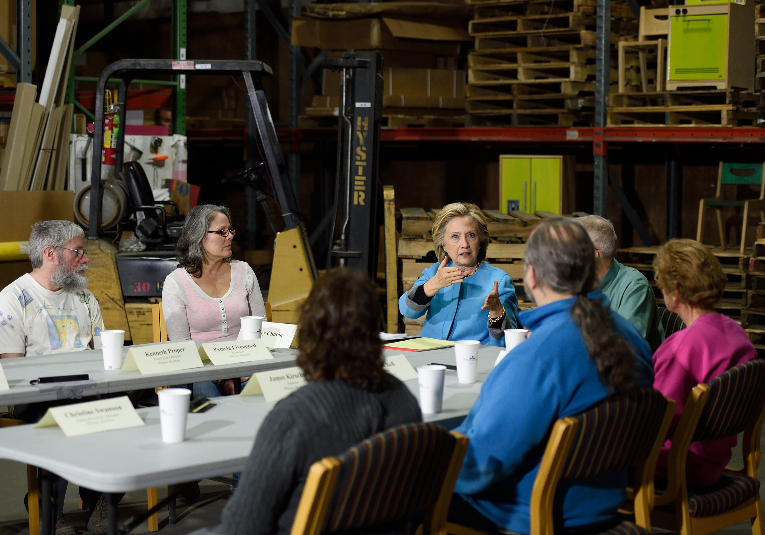 Hillary Clinton participates in a round table discussion with Pam Livengood, middle left, and Whitney Brothers management and employees in Keene, N.H. on April 20, 2015.