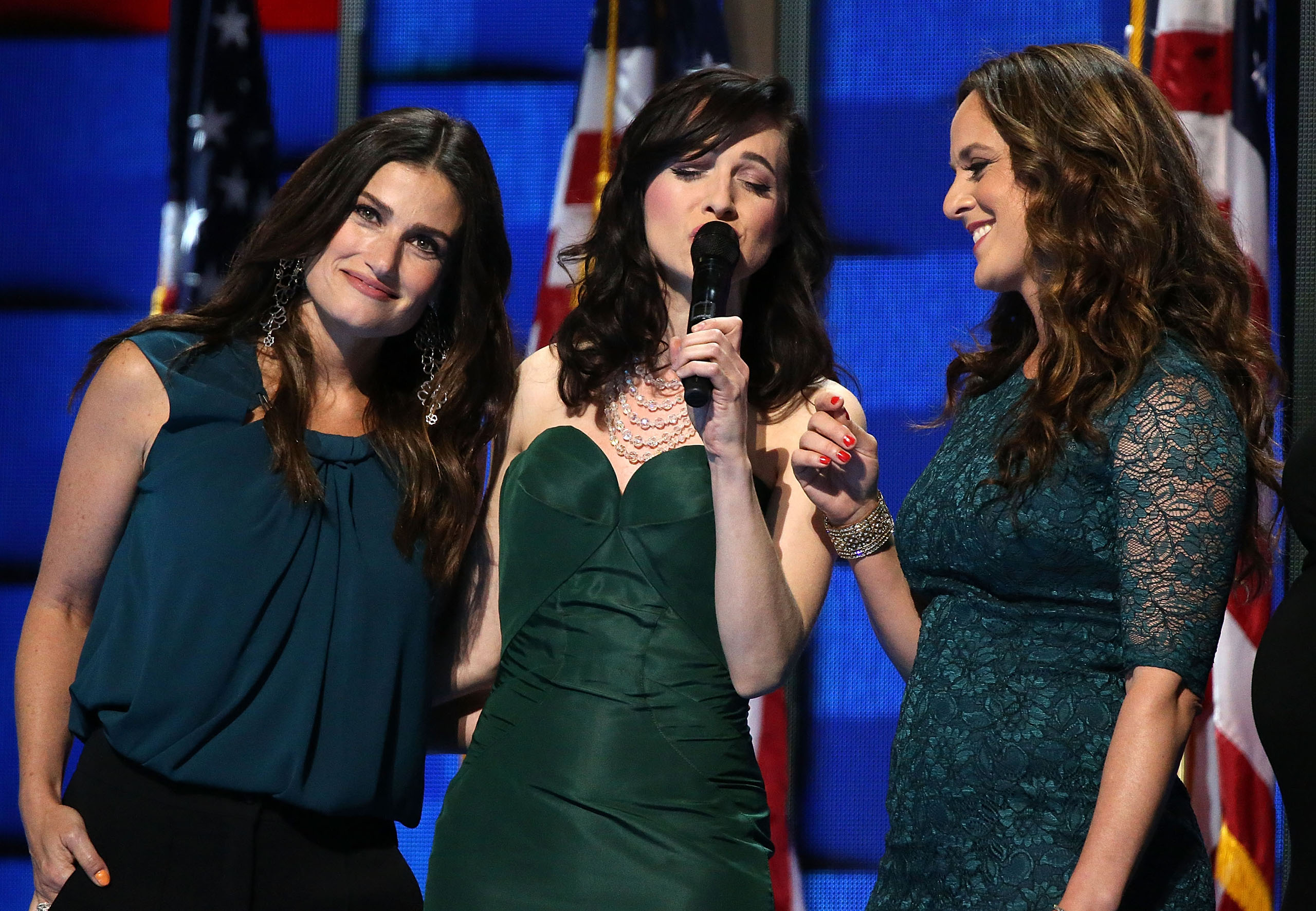 Singer Idina Menzel (L) joins the Stars of Broadway to perform 'What the World Needs Now' honoring those killed in the Pulse nightclub shooting in Orlando on the third day of the Democratic National Convention at the Wells Fargo Center in Philadelphia, Pennsylvania, on July 27, 2016.