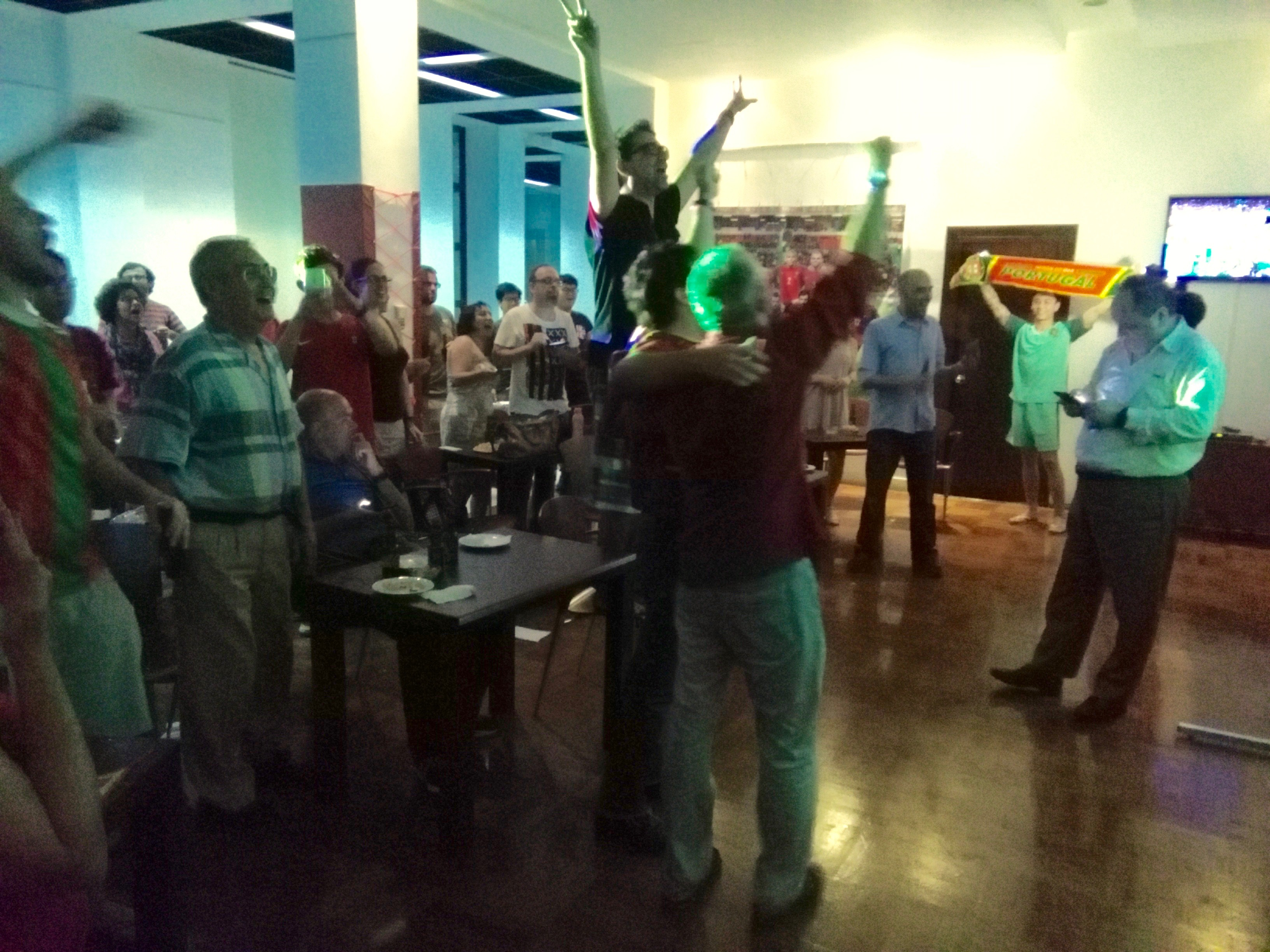 Fans of Portugal in Macau react as they watch a televised broadcast of their team defeating France in Euro 2016