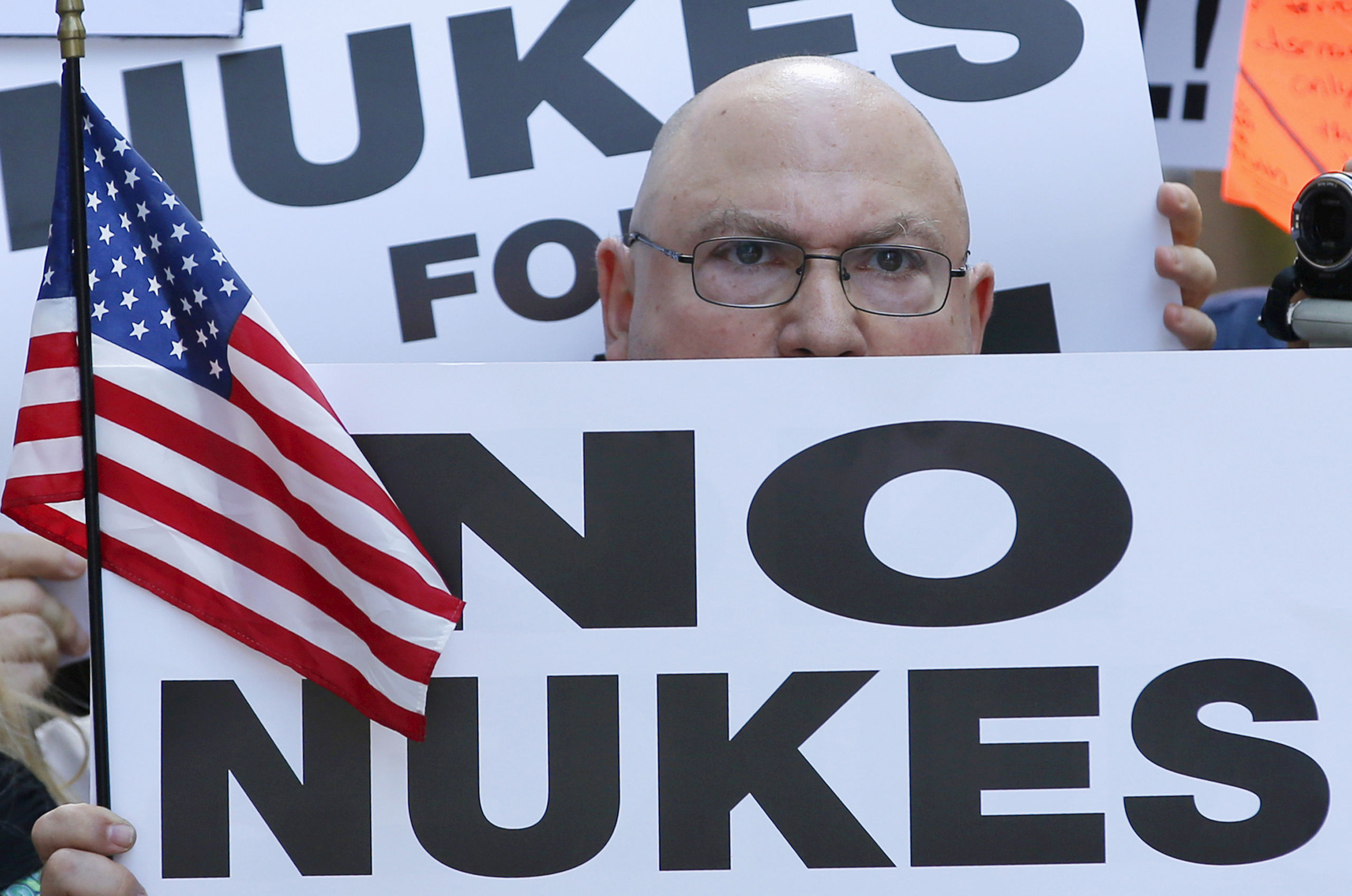 A man holds up a sign as he and several thousand other protestors demonstrate during a rally apposing the nuclear deal with Iran in Times Square in the Manhattan borough of New York City on July 22, 2015.