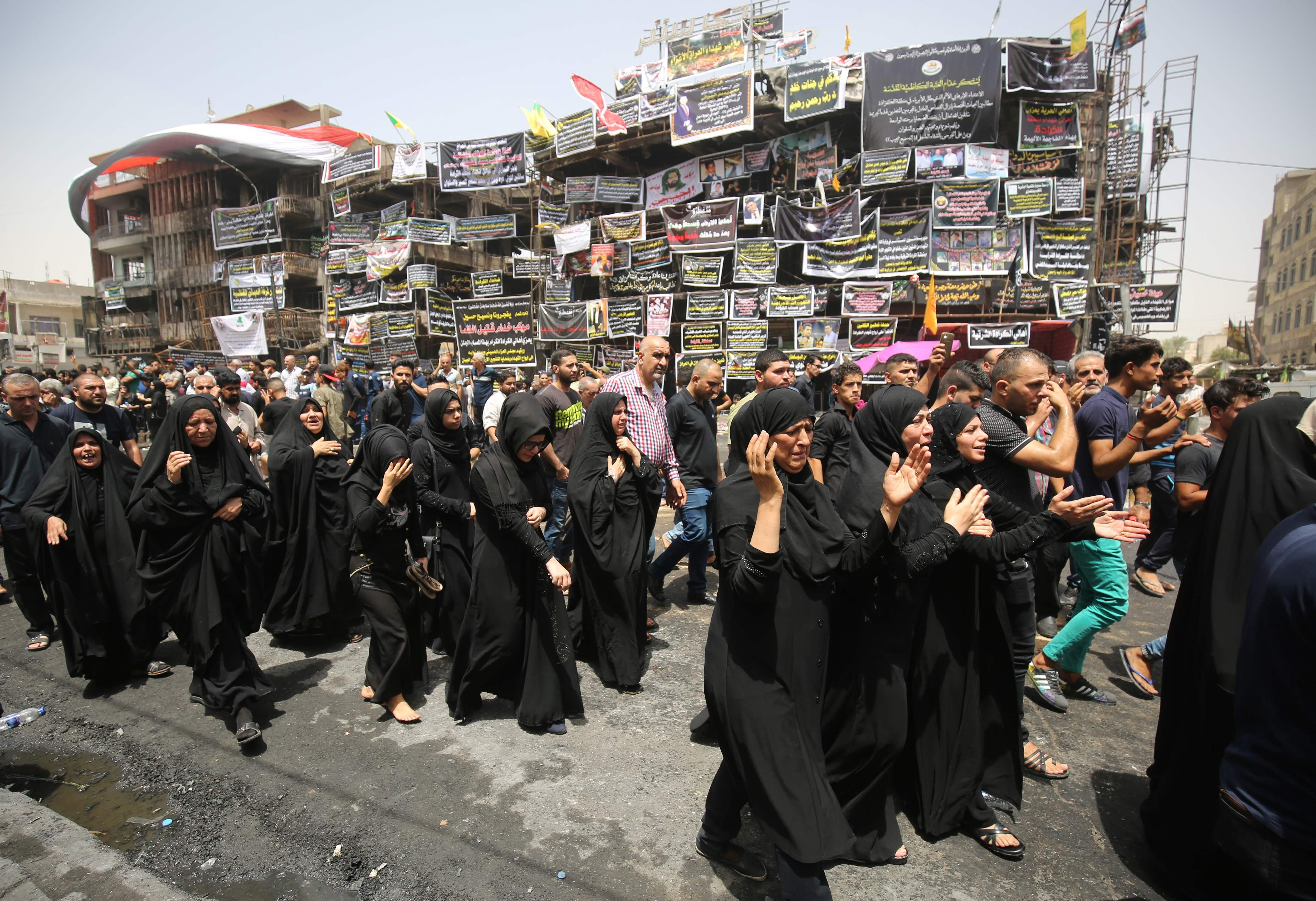 Mourners walk during the funeral of an Iraqi man who was killed in a suicide bombing attack in Baghdad, on July 6, 2016.