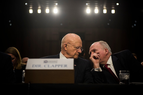 Director of National Intelligence James Clapper speaks to CIA Director John Brennan before the start of the Senate (Select) Intelligence Committee hearing at the Hart Senate Building on February 9, 2016 in Washington, D.C.