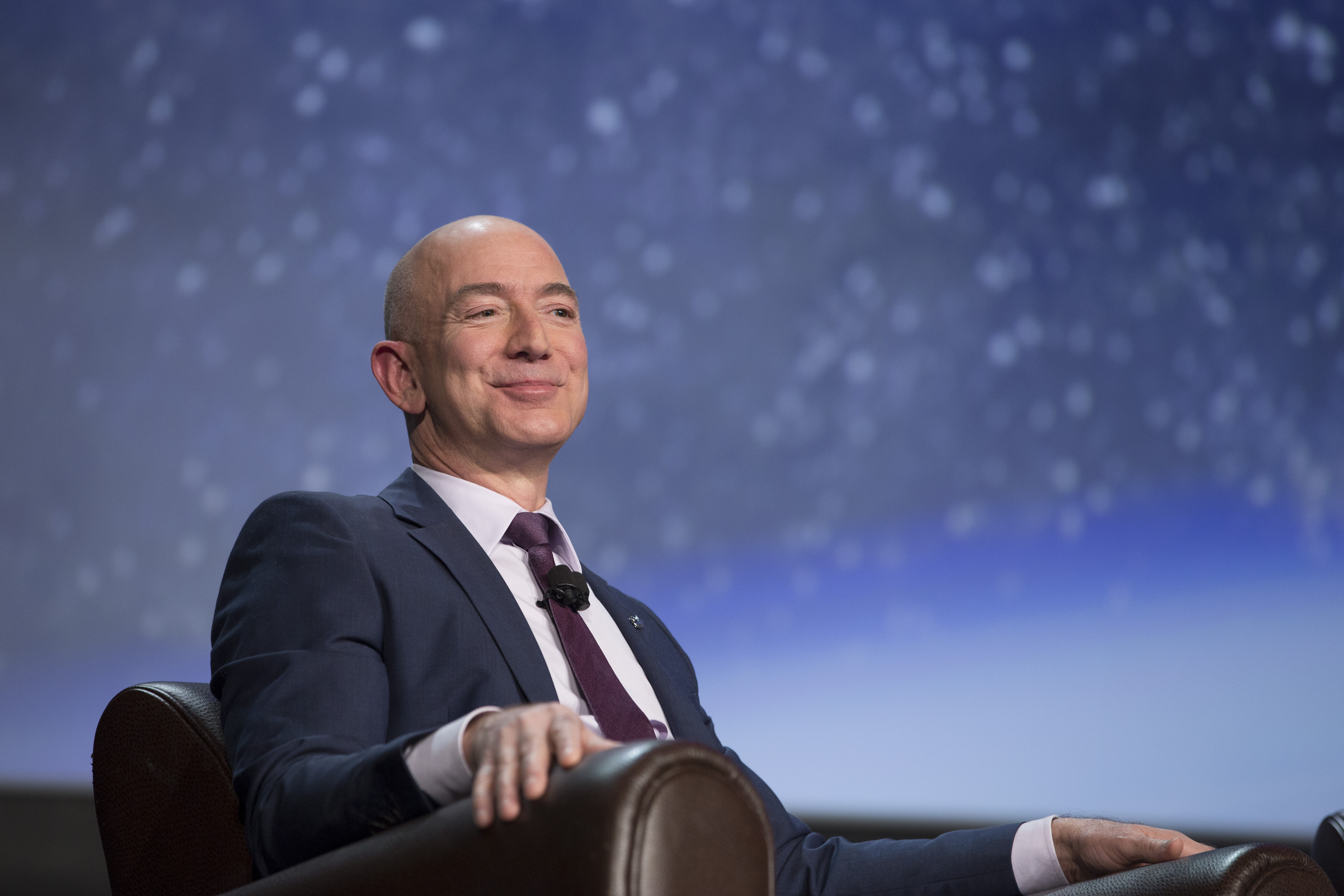 Jeff Bezos, chief executive officer of Amazon.com Inc. and founder of Blue Origin LLC, smiles during the 32nd Space Symposium in Colorado Springs, Colorado, on April 12, 2016.