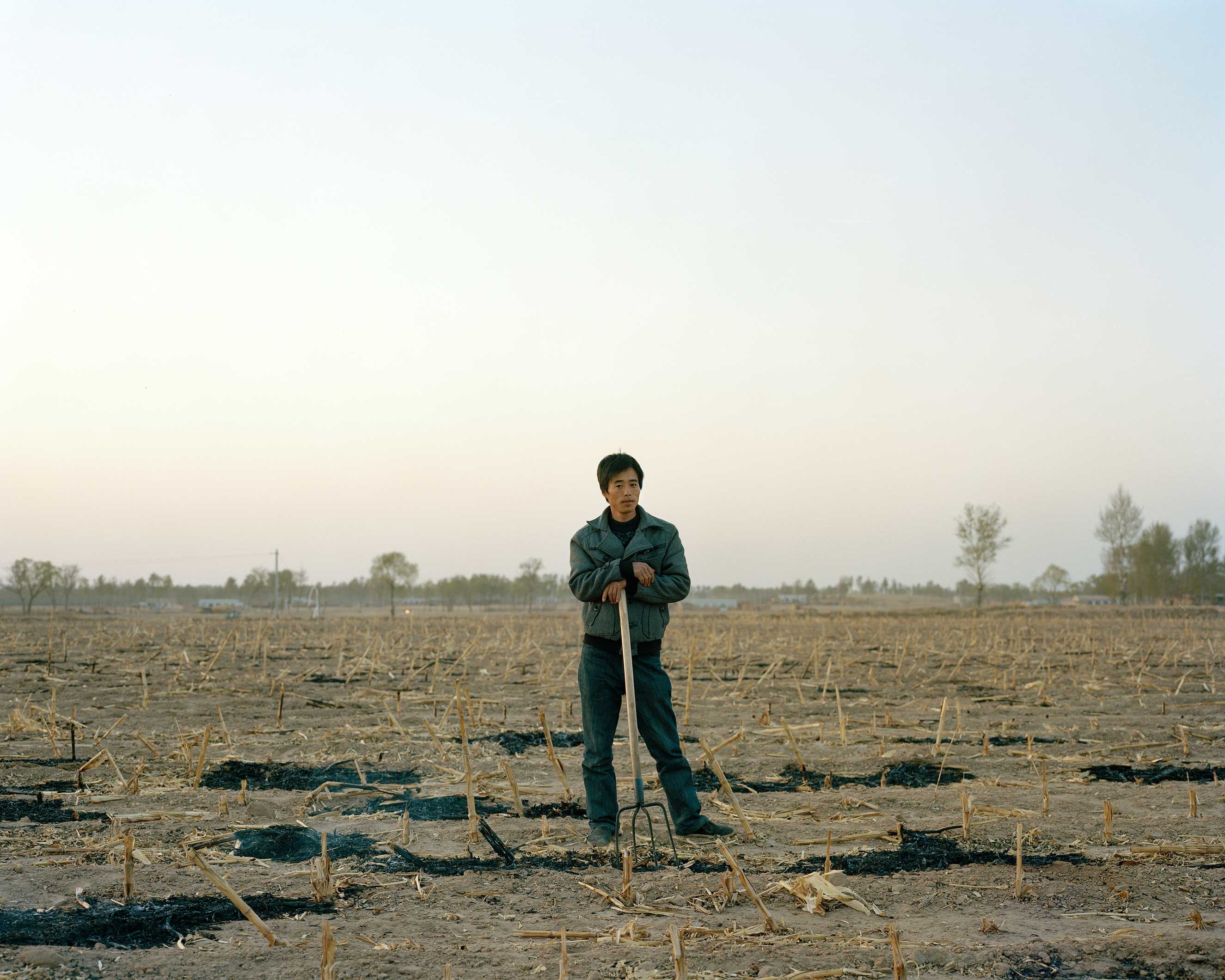 Dingbian, Shaanxi, China, April 2013. Thirty-one year old farmer.