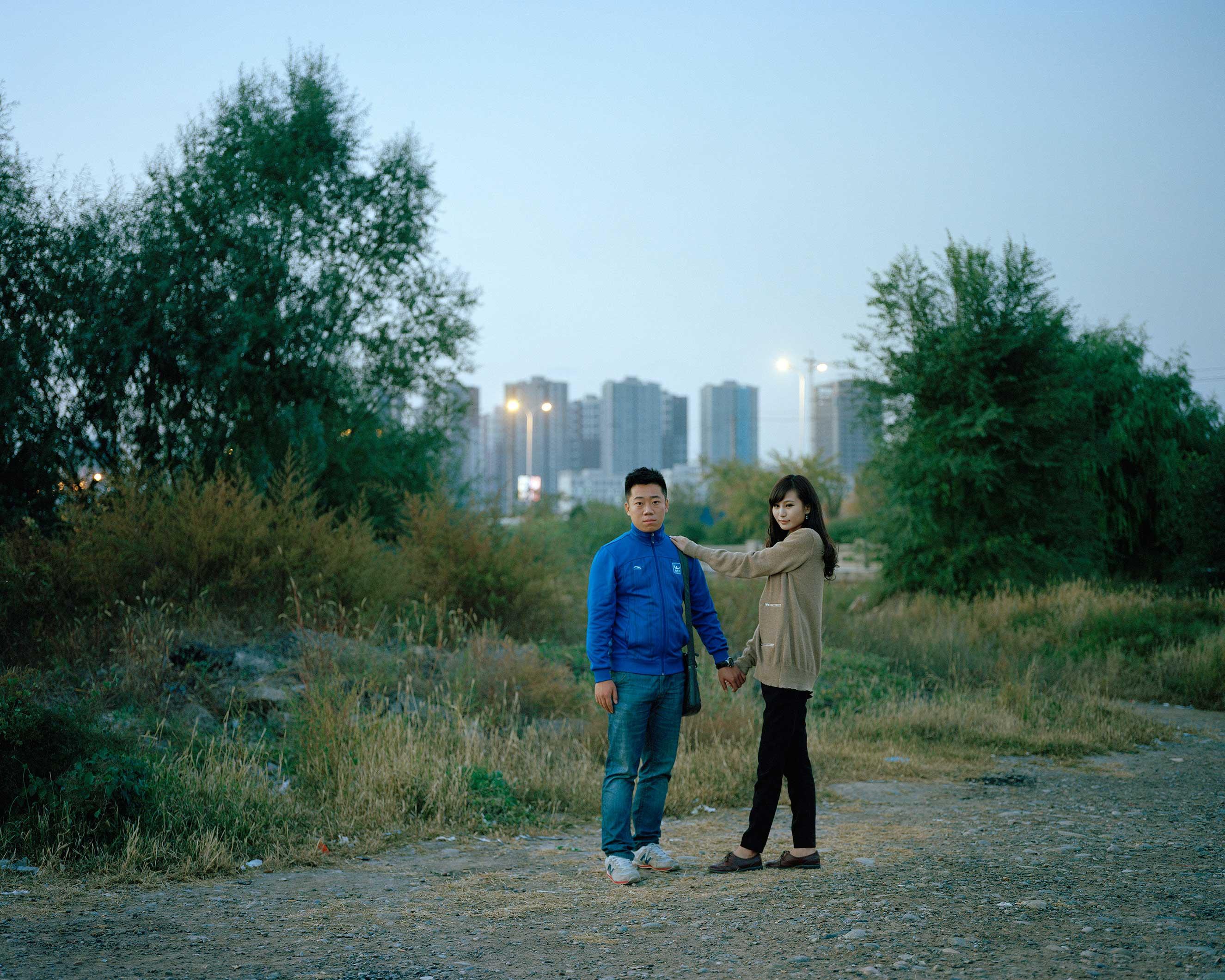 Lanzhou, Gansu Province, China, October 2013. Hu Xiao and his girlfriend Lan Xiaomei, both 23 years old, by the Yellow river.