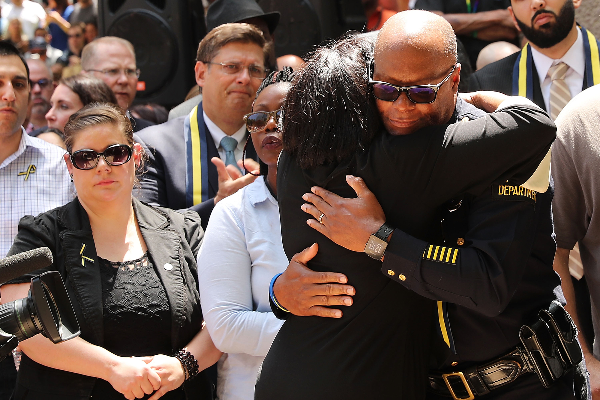 Dallas Police Chief David Brown is greeted with a hug at a prayer vigil following the deaths of five police officers in Dallas on July 8, 2016.