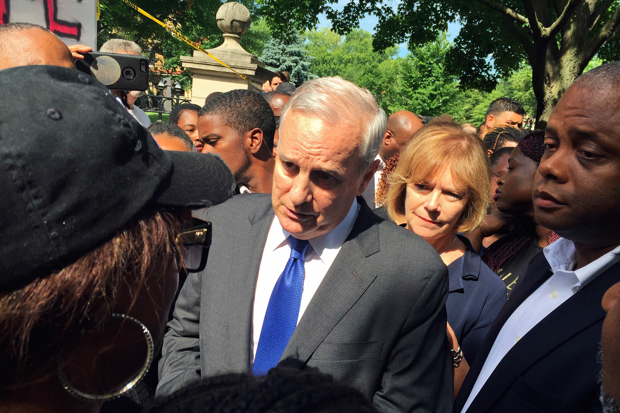 Minn. Gov. Mark Dayton expresses his condolences to Diamond Reynolds for the death of her boyfriend, Philando Castile, outside the governor's residence in St. Paul, Minn. on July 7, 2016.