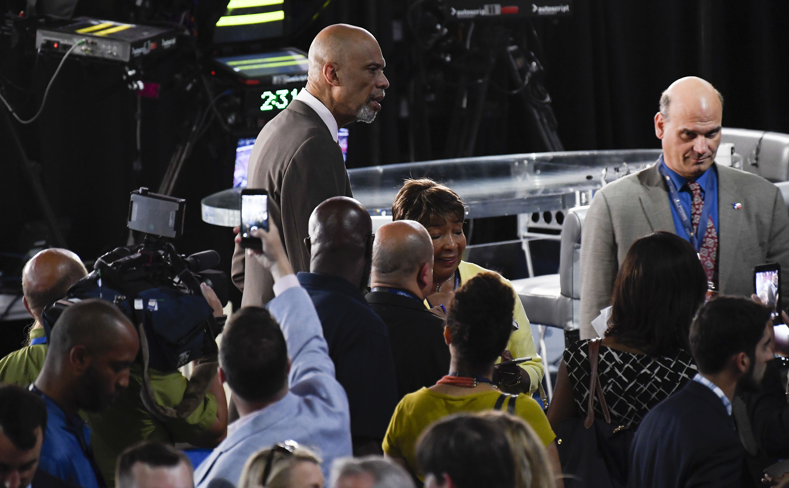 Former NBA star Kareem Abdul-Jabbar towers above the crowd as he poses for photos on the floor before the start of day two of the Democratic National Convention in Philadelphia, Pennsylvania, on July 26, 2016.