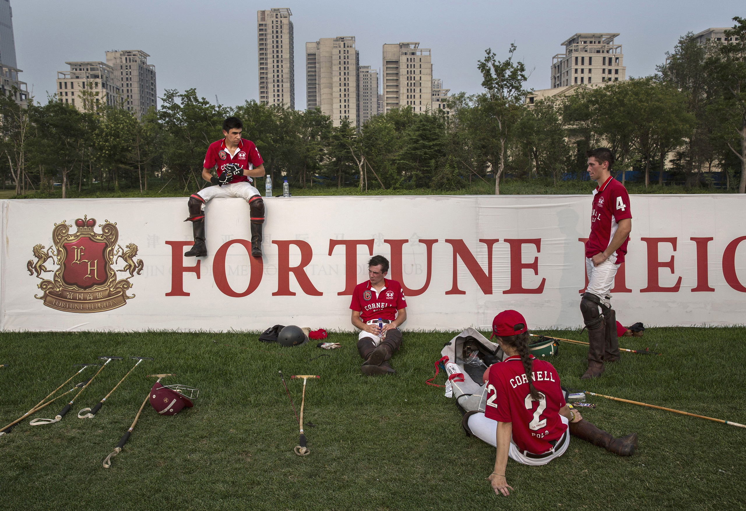 Players from the Cornell University polo team rest during a break in a match during the intervarsity tournament held at the Tianjin Goldin Metropolitan Polo Club in Tianjin, China, on July 17, 2016.