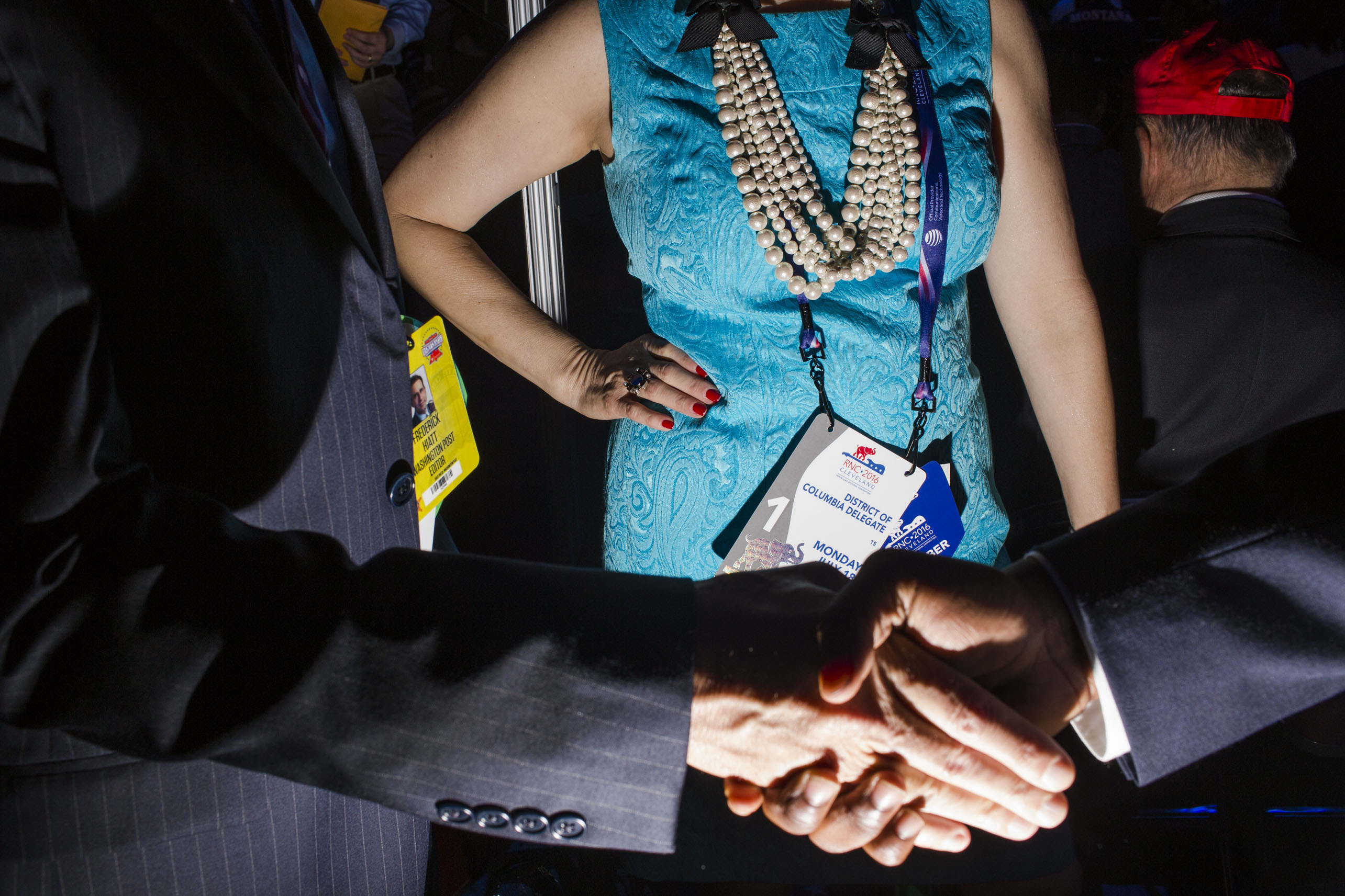 Women accessorize while some men wear classic pinstripes on the floor of the 2016 Republican National Convention on Monday, July 18, 2016, in Cleveland.