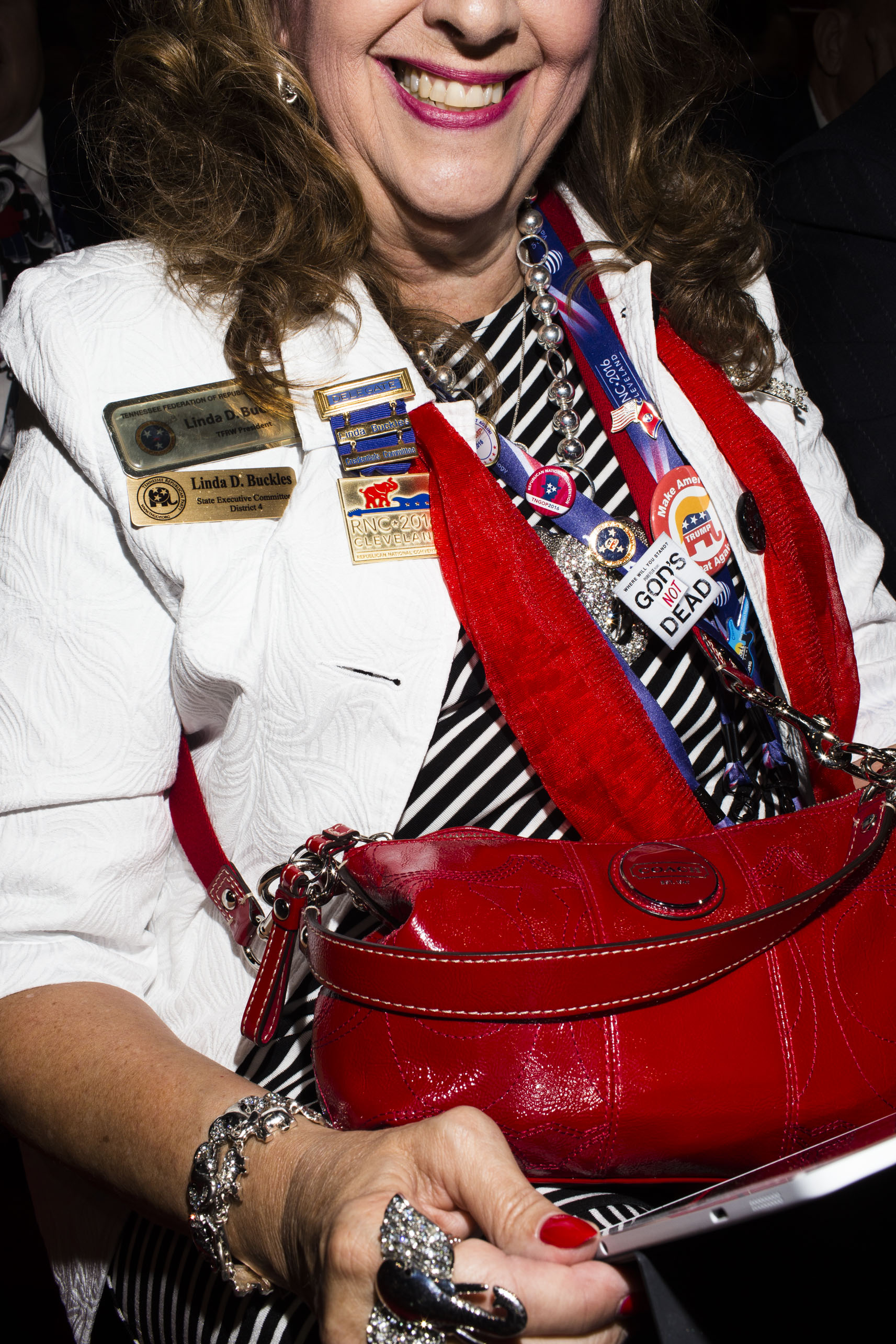 Pins are popular on the floor of the 2016 Republican National Convention on Monday, July 18, 2016, in Cleveland.