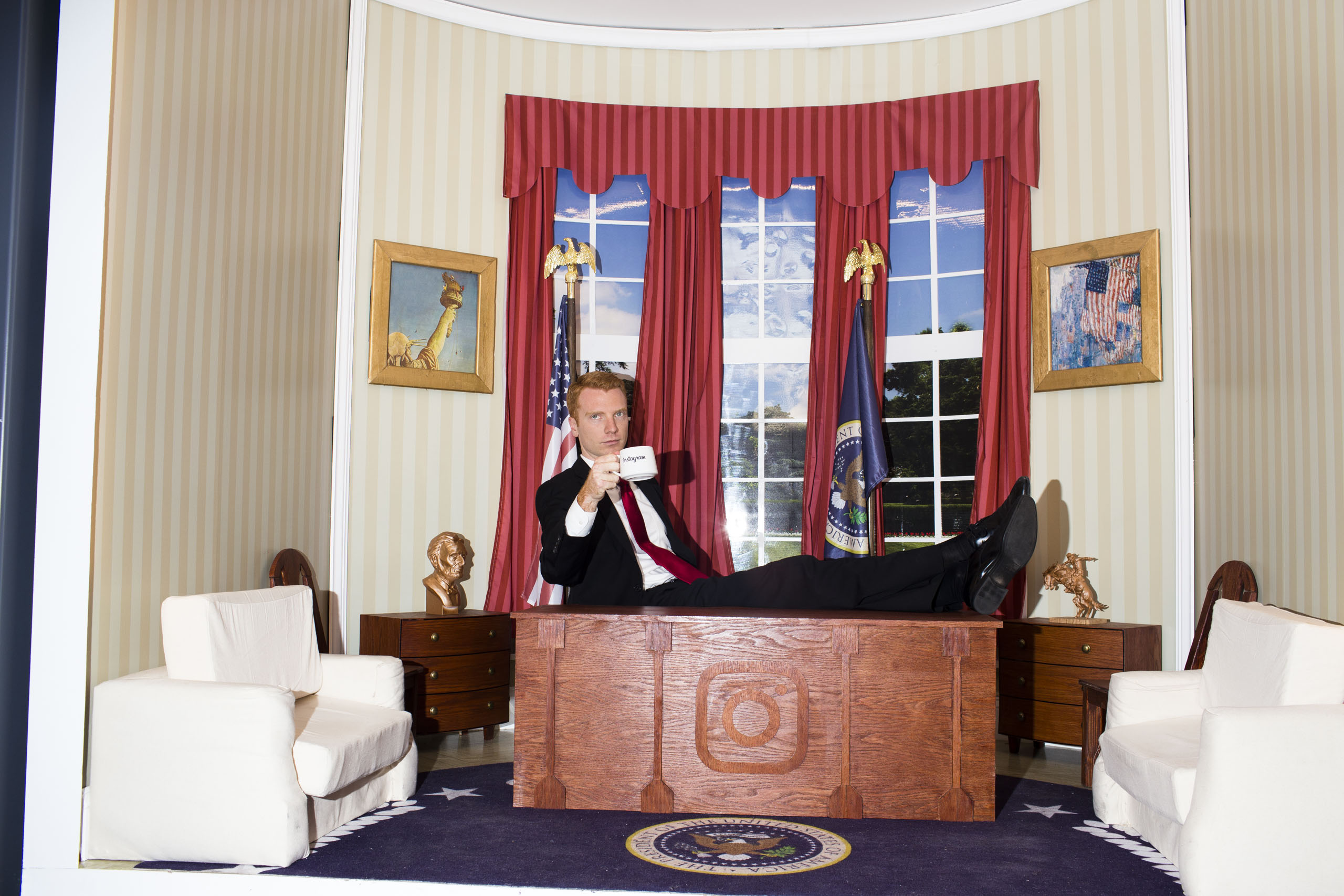 "A man poses at Instagram's ""Mini Oval"" office at the 2016 Republican National Convention in Cleveland on Wednesday, July 20, 2016."