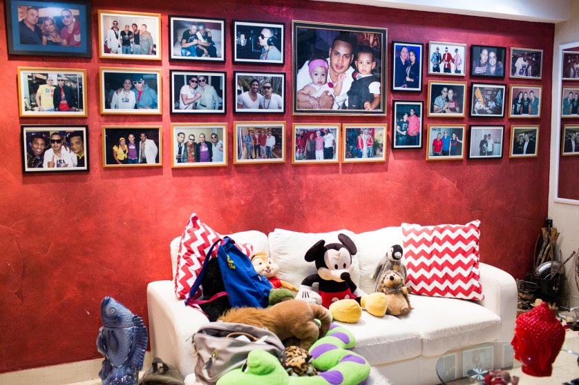 "Artist Jacob Forever's living room in Havana on May 14, 2015. His wall is covered with photos of himself and various famous Cuban singers. Jacob recently signed with Sony records after the release of his hit song ""Hasta Que Se Seque el Malec�n."""