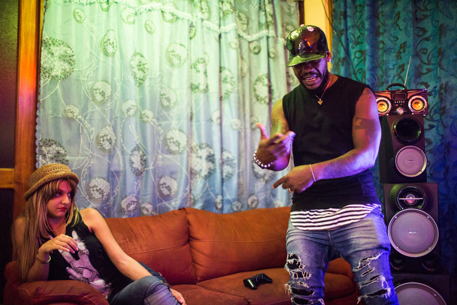 Damian from Los Desiguales practices a rap before his video shoot for  Infelices  at his home in Havana, while his girlfriend watches on Sept.10, 2015.
