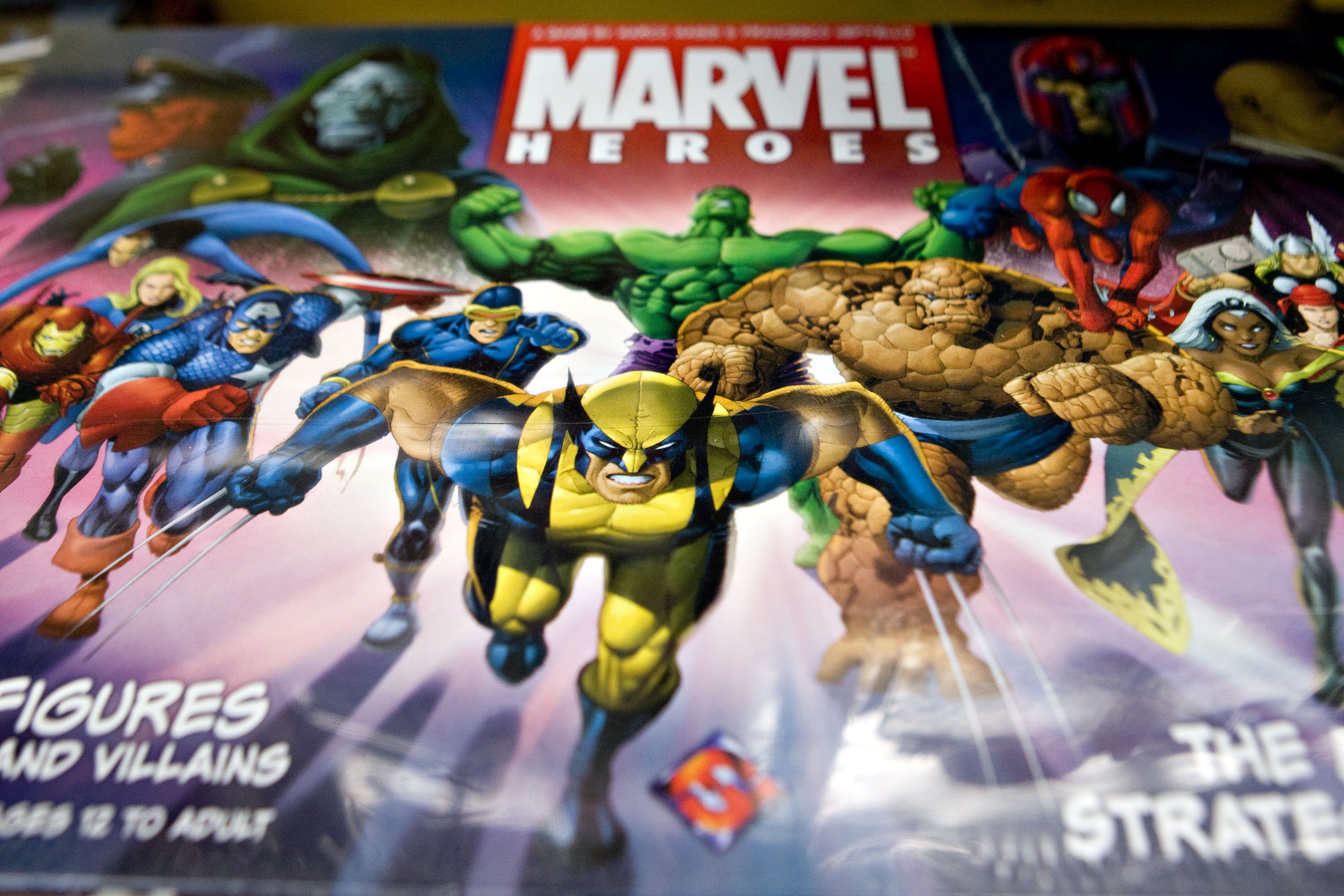 Marvel comic book characters including Wolverine, Captain America, and the Incredible Hulk appear on a Marvel Heroes board game displayed for a photograph at Midtown Comics in New York, U.S., on Aug. 31, 2009.
