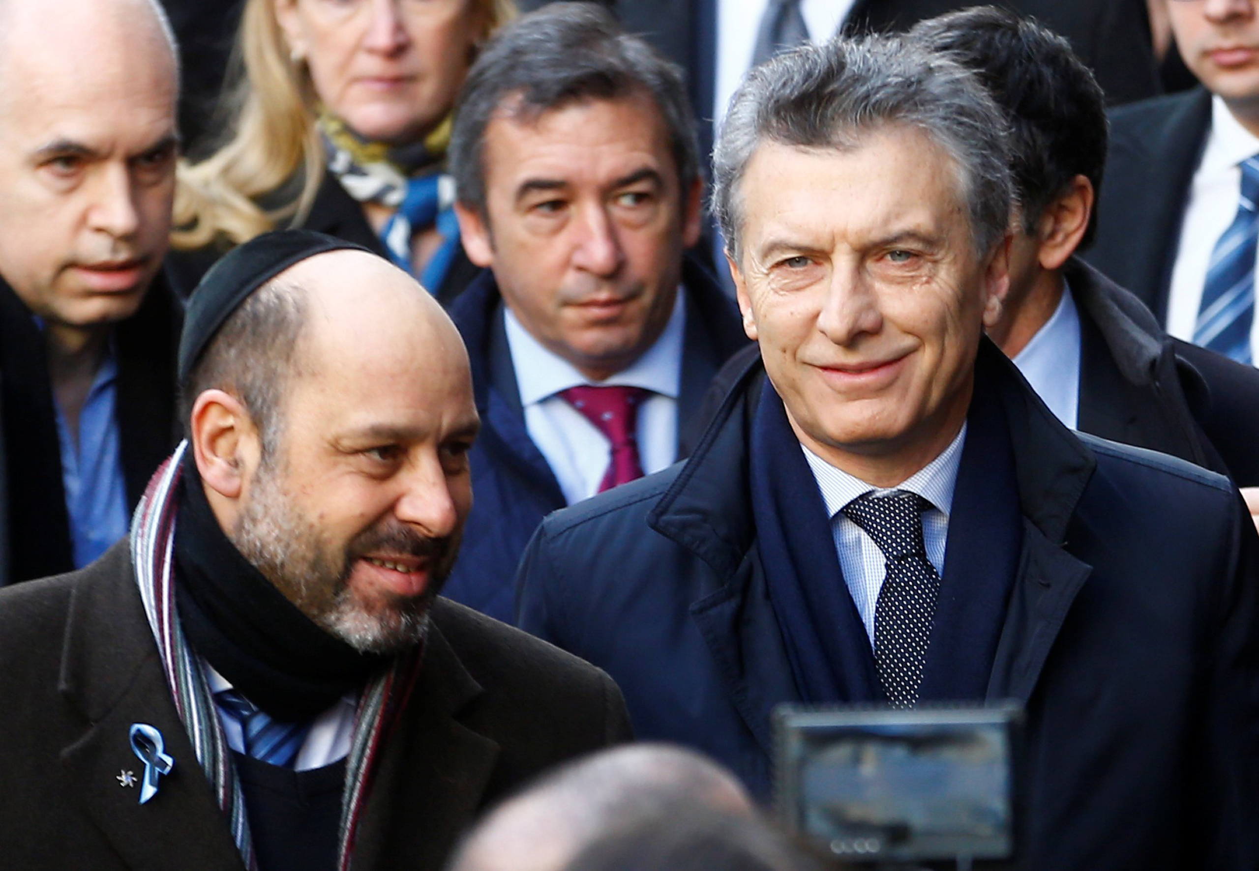 Argentine President Mauricio Macri accompanied by AMIA's Vice President Ralph Thomas Saieg arrives to attend a ceremony marking the 22nd anniversary of the 1994 attack that left 85 dead at the AMIA Jewish center in Buenos Aires, on July 18, 2016.