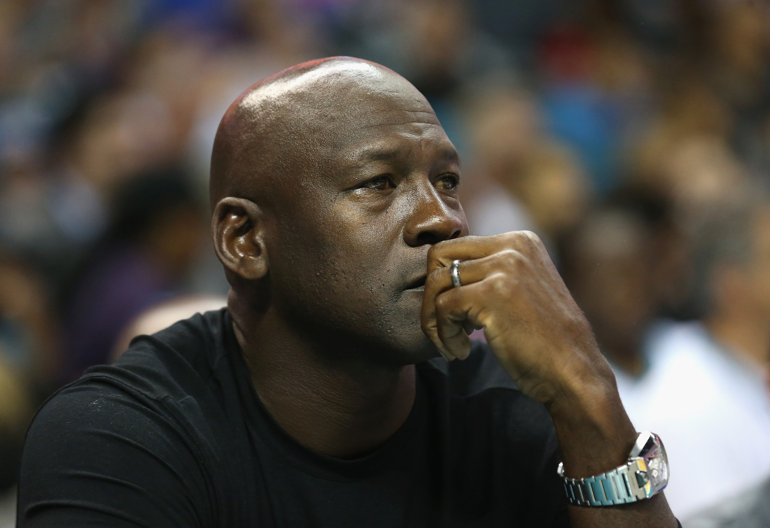 Owner of the Charlotte Hornets, Michael Jordan, watches on during their game against the Atlanta Hawks at Time Warner Cable Arena on in Charlotte on November 1, 2015.