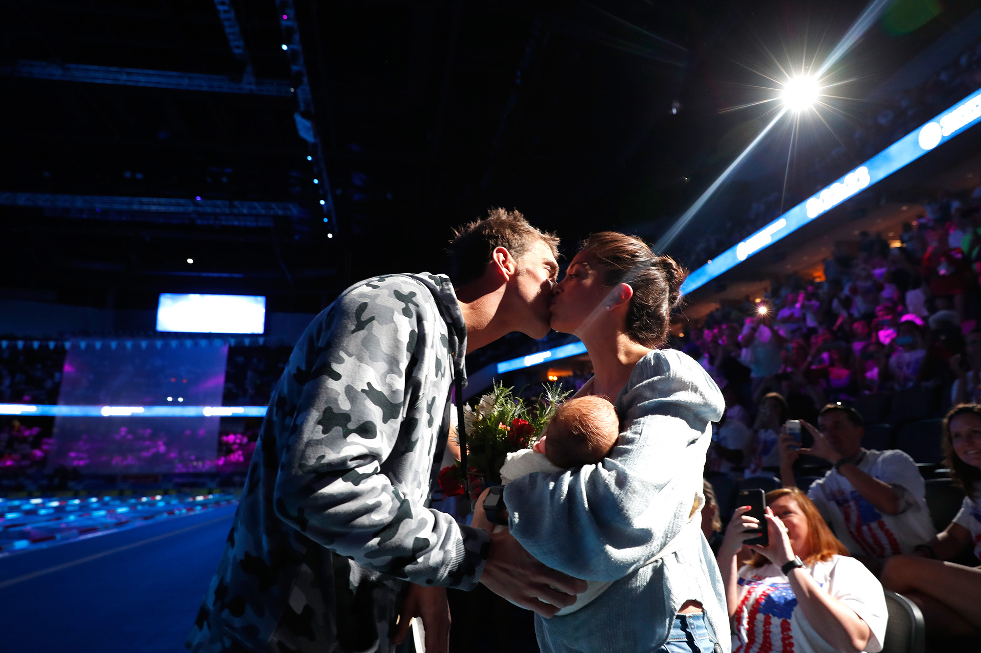 Michael Phelps of the United States celebrates with his fiancee Nicole Johnson and their son Boomer after finishing first in the final heat for the Men's 200 Meter Individual Medley during Day Six of the 2016 U.S. Olympic Team Swimming Trials at CenturyLink Center on July 1, 2016 in Omaha, Nebraska.  (Photo by Al Bello/Getty Images)