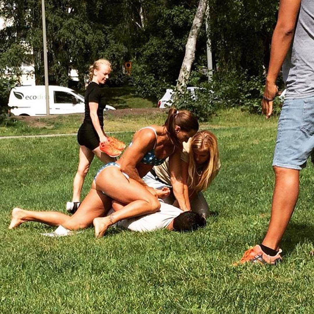 In this photo provided by Jenny Kitsune Adolffson, off-duty police officer Mikaela Kellner pins a man to the ground who was suspected to have stolen a friend's mobile phone, in Stockholm on July 27, 2016.