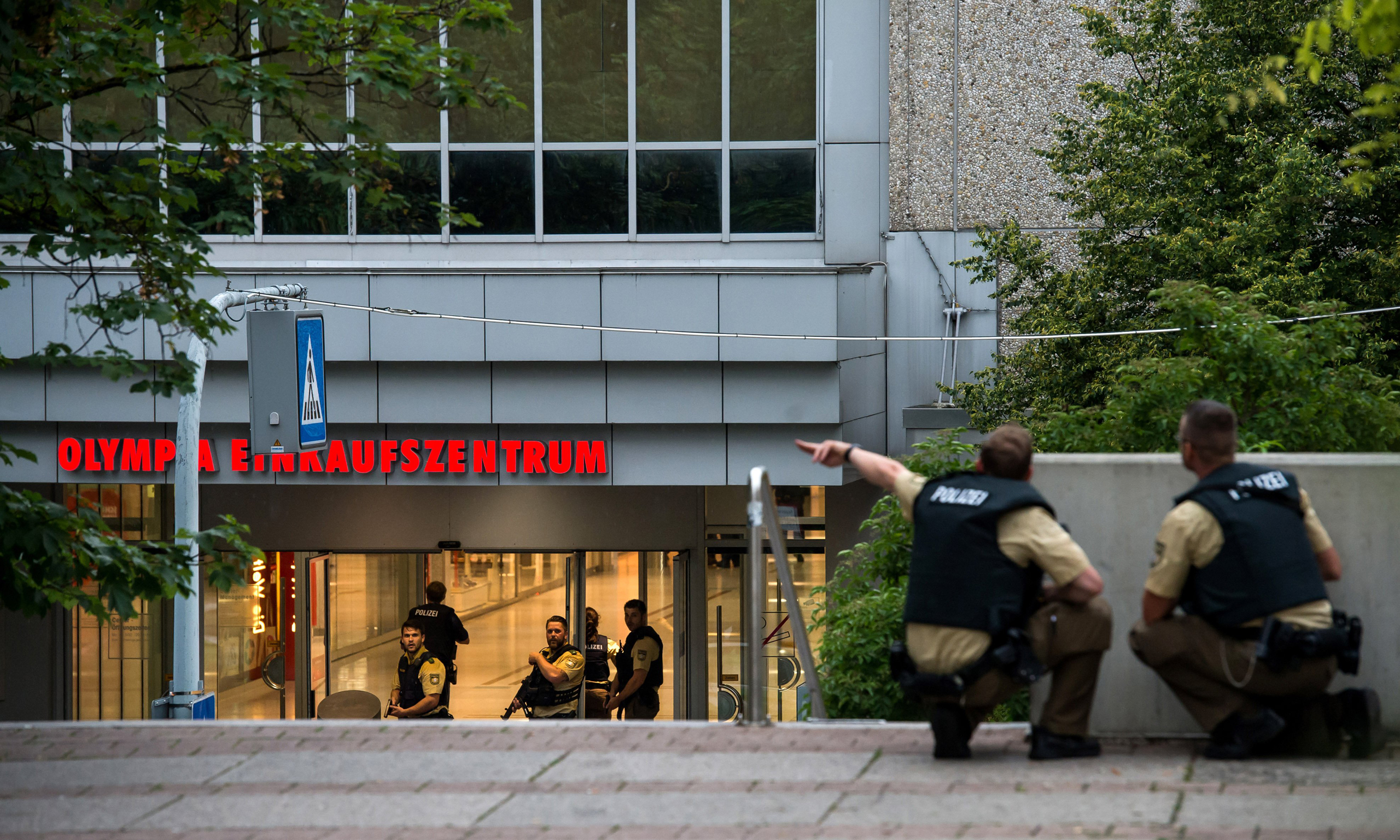 Police officers respond to a shooting at the Olympia Einkaufzentrum (OEZ) in Munich, Germany on July 22, 2016.