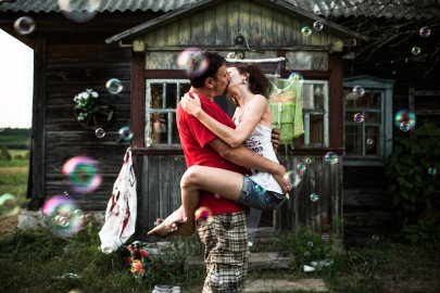Zhenya (Evgeny) and Yulia kiss in front of their datcha during their wedding celebration with their friends, on June 22, 2013 in Slavutych, Ukraine.