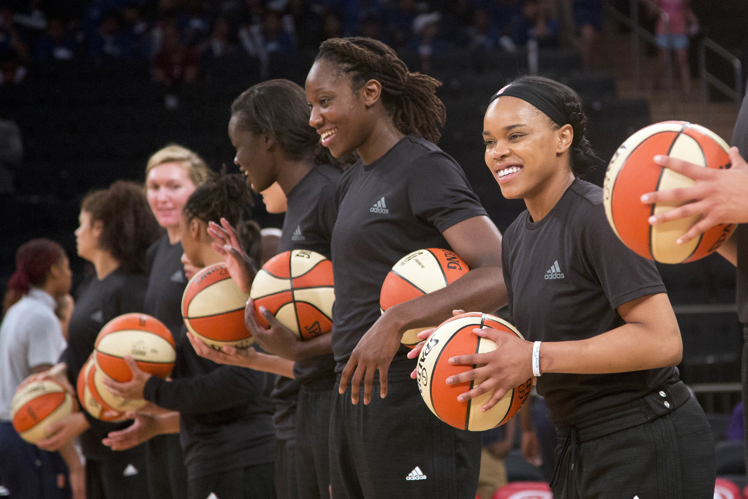 Members of the New York Liberty basketball team await the start of a game against the Atlanta Dream in New York City on July 13, 2016.