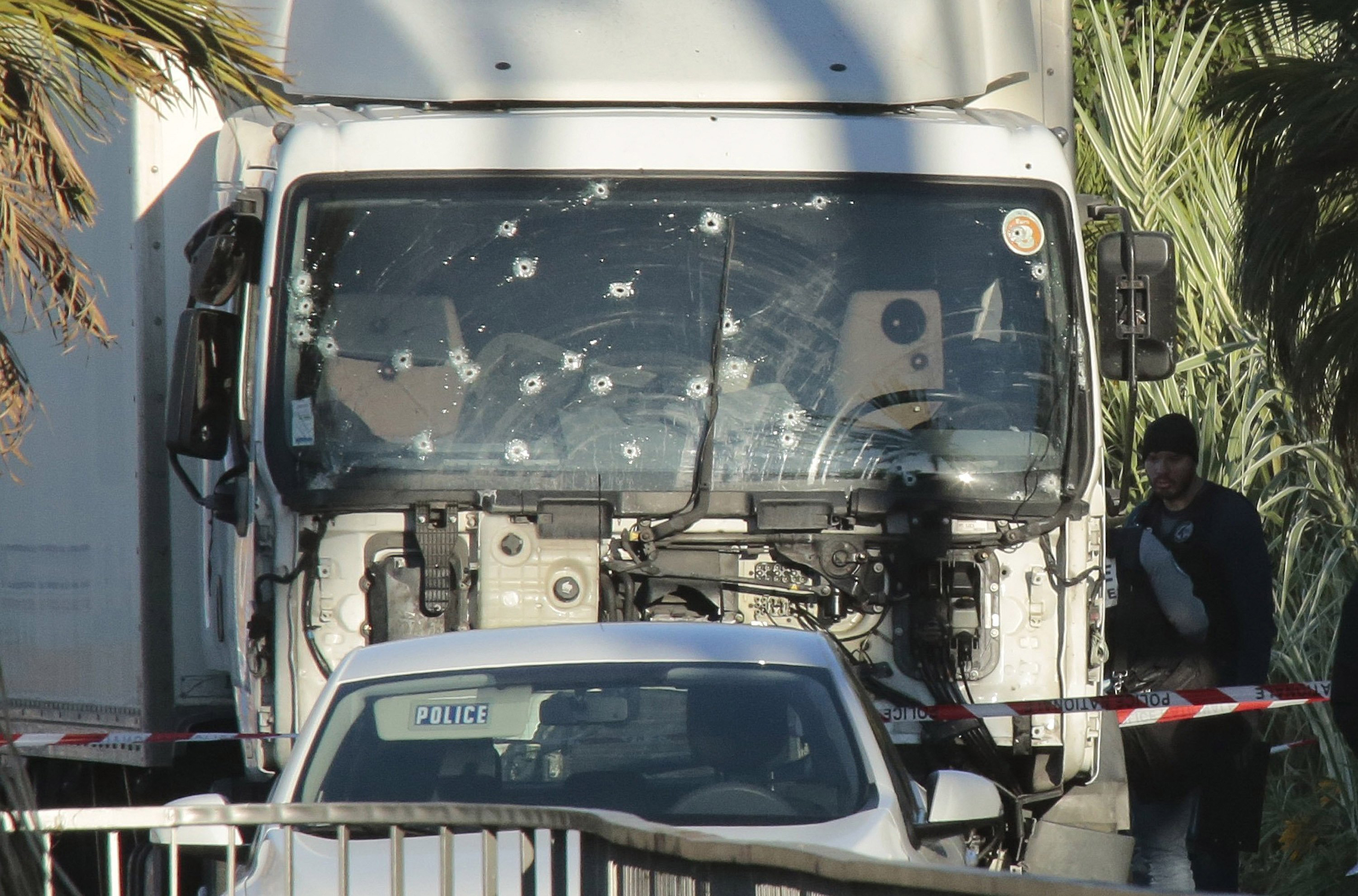 Forensic police investigate the truck at the scene of the terror attack on the Promenade des Anglais in Nice, France, on July 15, 2016. Authorities said a French-Tunisian attacker killed 84 people as he drove a truck through crowds, gathered to watch a firework display during Bastille Day celebrations. The attacker then opened fire on people in the crowd before being shot dead by police. Patrick Aventurier—Getty Images