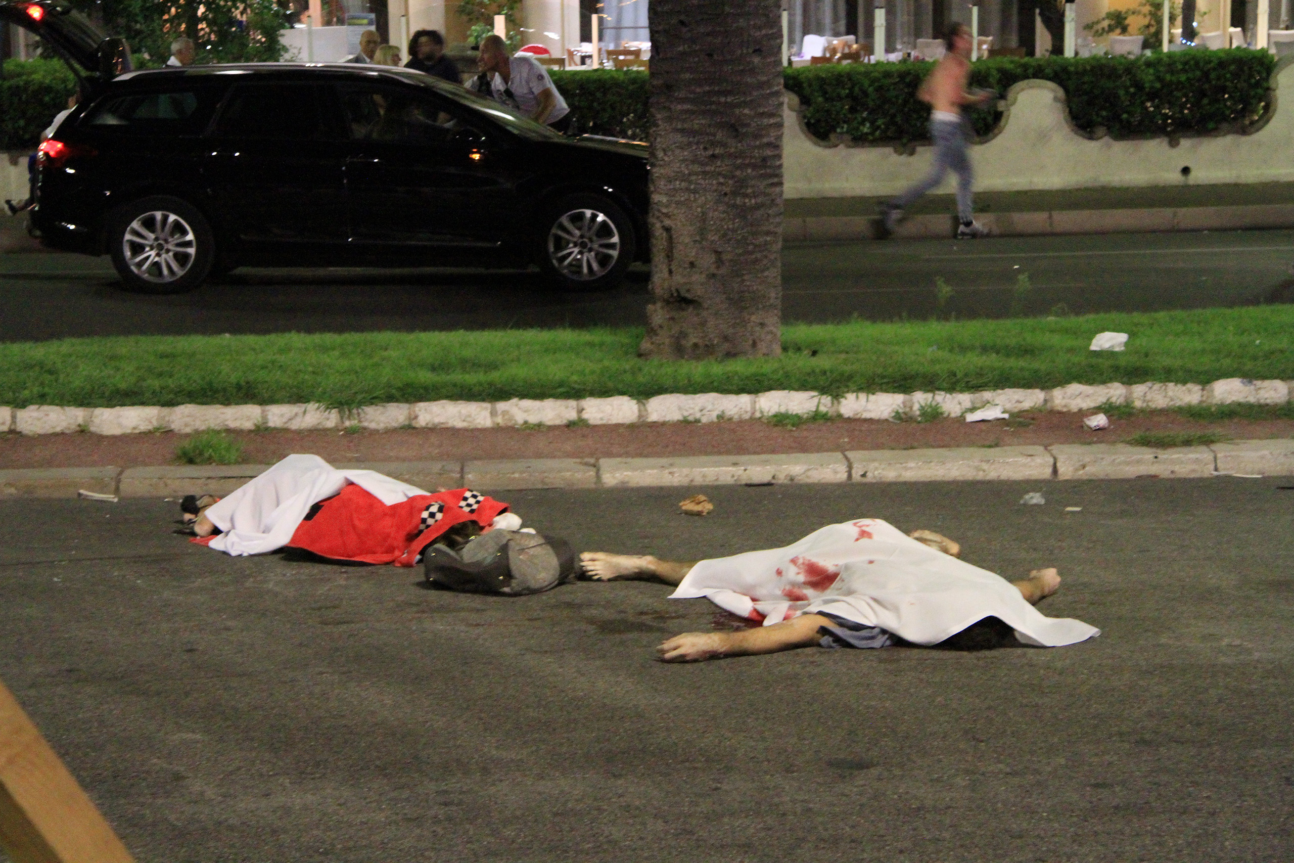Bodies lie in the streets of Nice, France, after a terrorist attack left at least 77 dead and dozens injured on July 14, 2016.