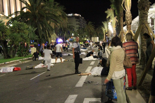 Wounded and dead bodies lie on the ground in Nice, France, July 14, after a truck crashed into a crowd on the Promenade des Anglais.