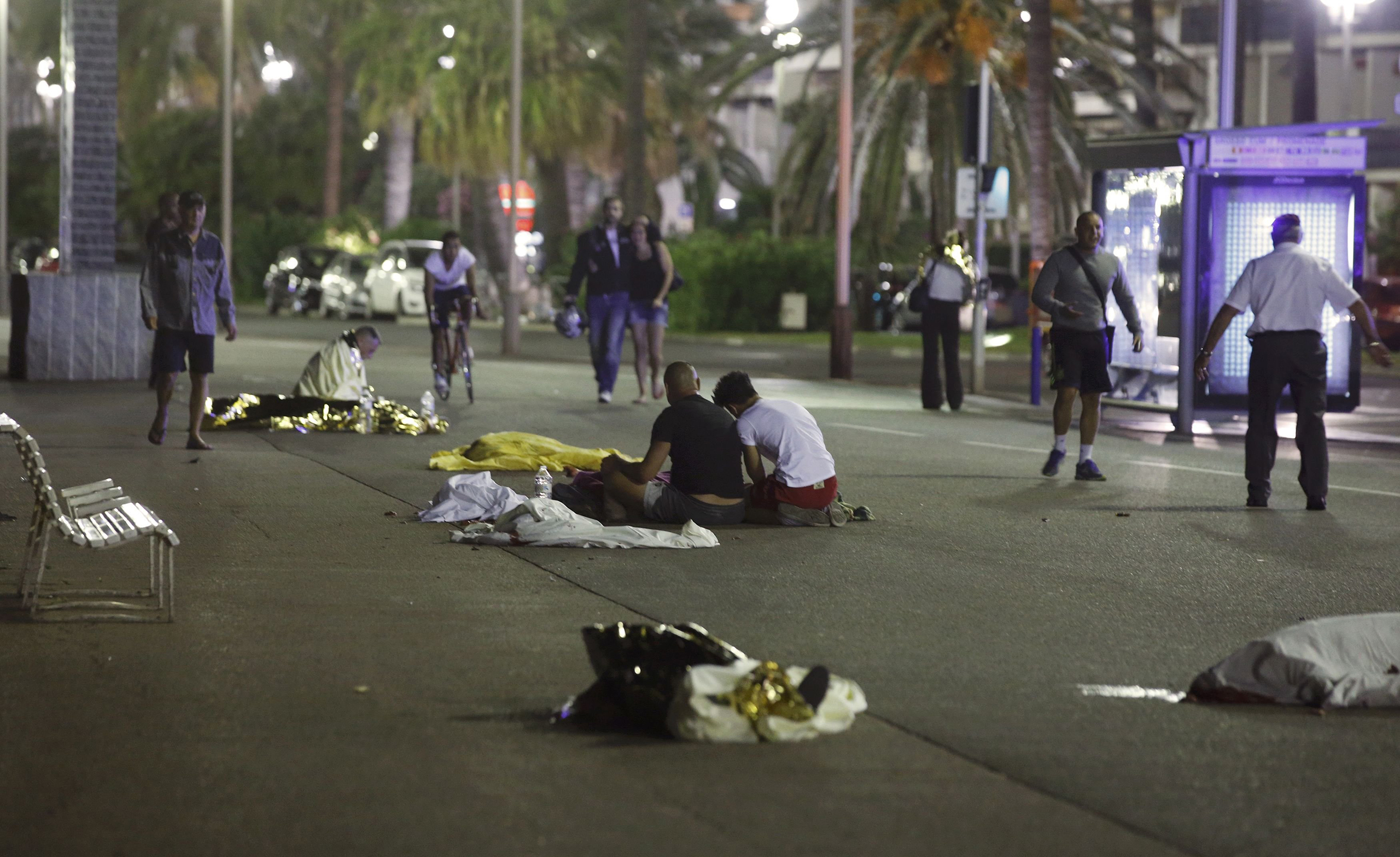 Bodies are seen on the ground on July 15, 2016, after at least 80 people were killed in Nice, France, when a truck ran into a crowd celebrating Bastille Day.