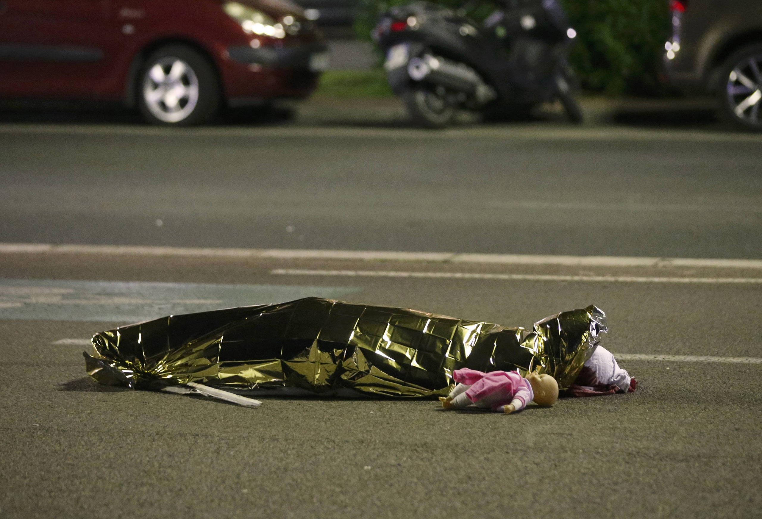 A body is seen on the ground on July 15, 2016, after at least 70 people were killed in Nice, France, when a truck ran into a crowd celebrating Bastille Day.